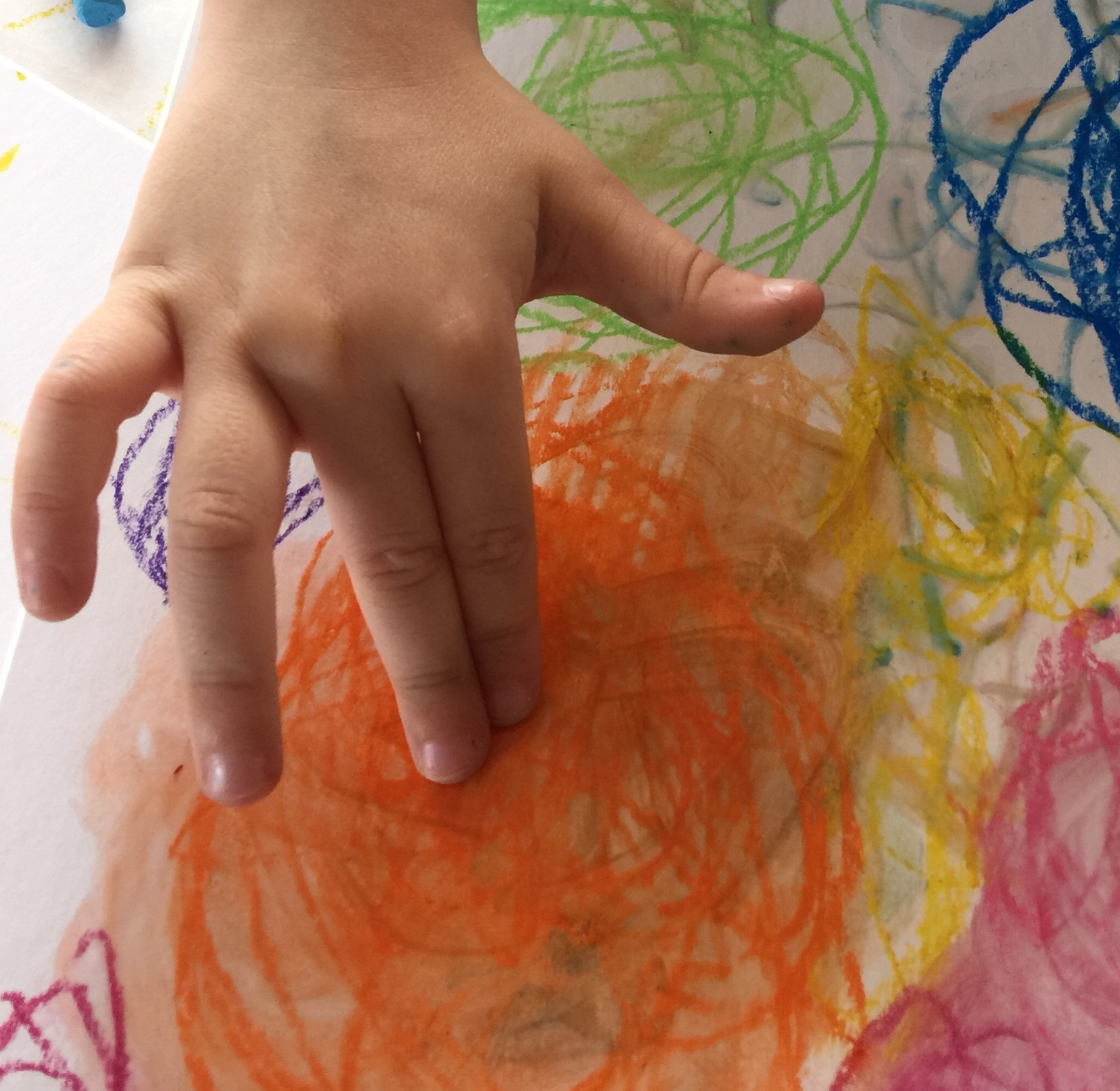 Oil pastel swirls turn painterly when you rub them with fingers dipped into baby oil.
