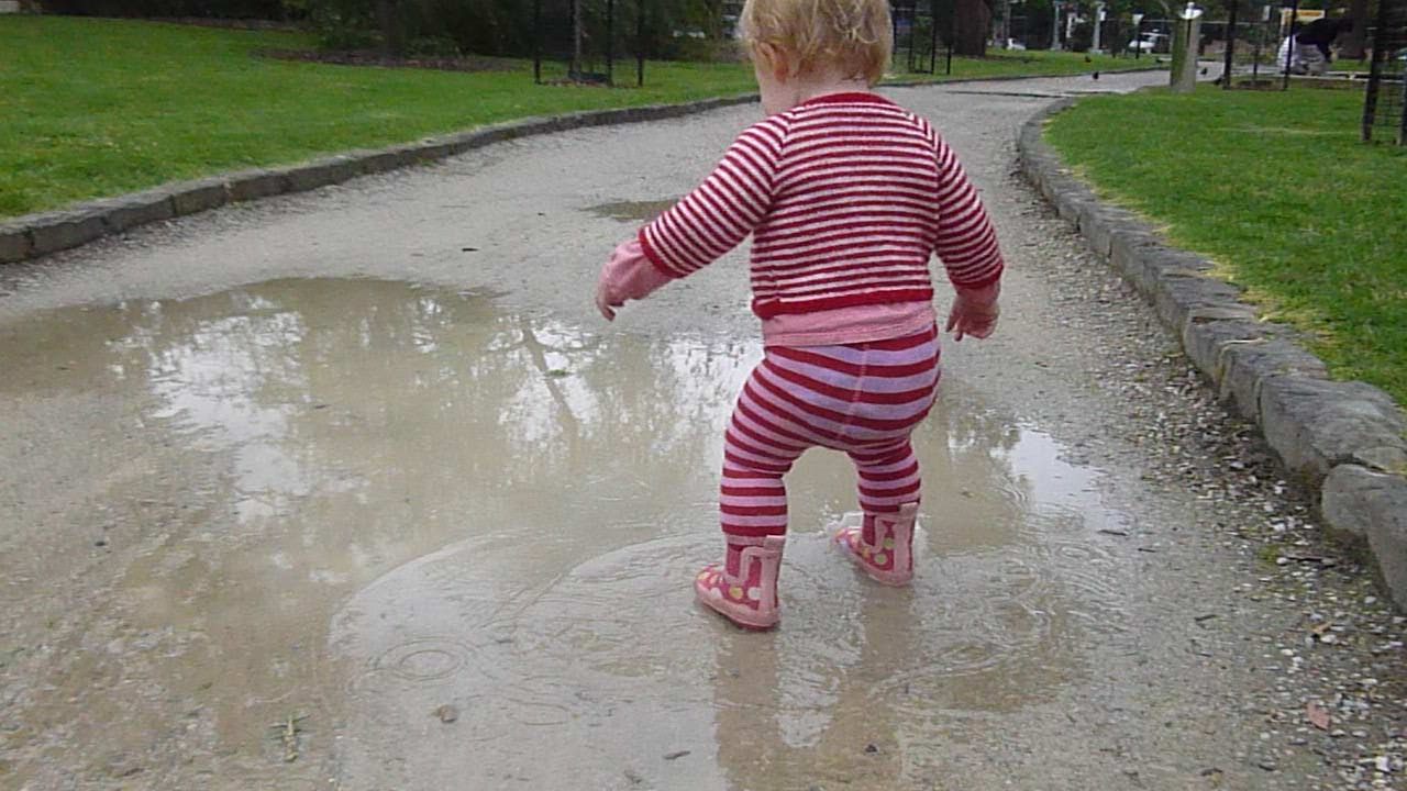 a simple walk through the park is more fun when there are puddles.