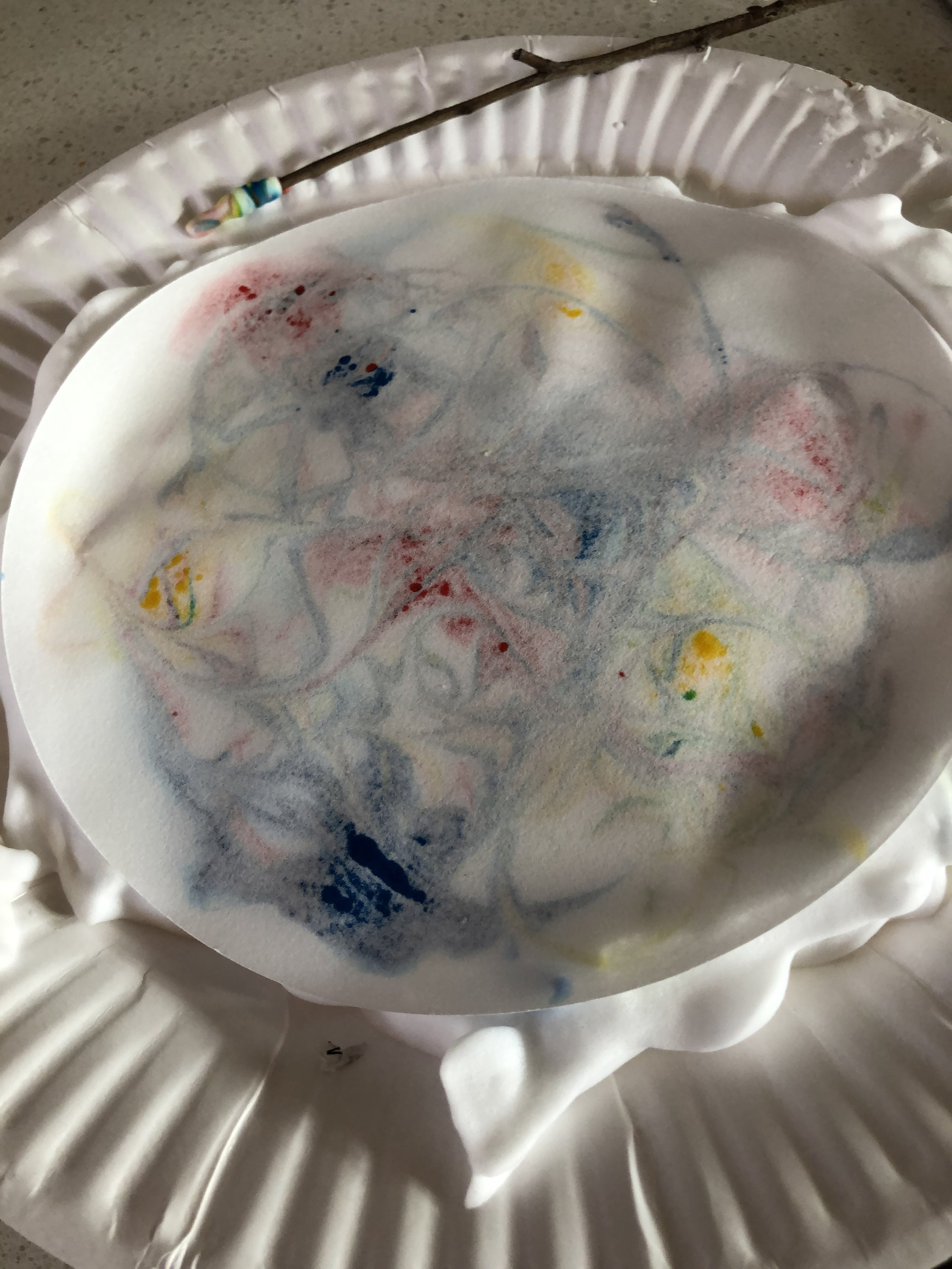 Float your paper onto the surface. Can you see the dyes soaking into it ?