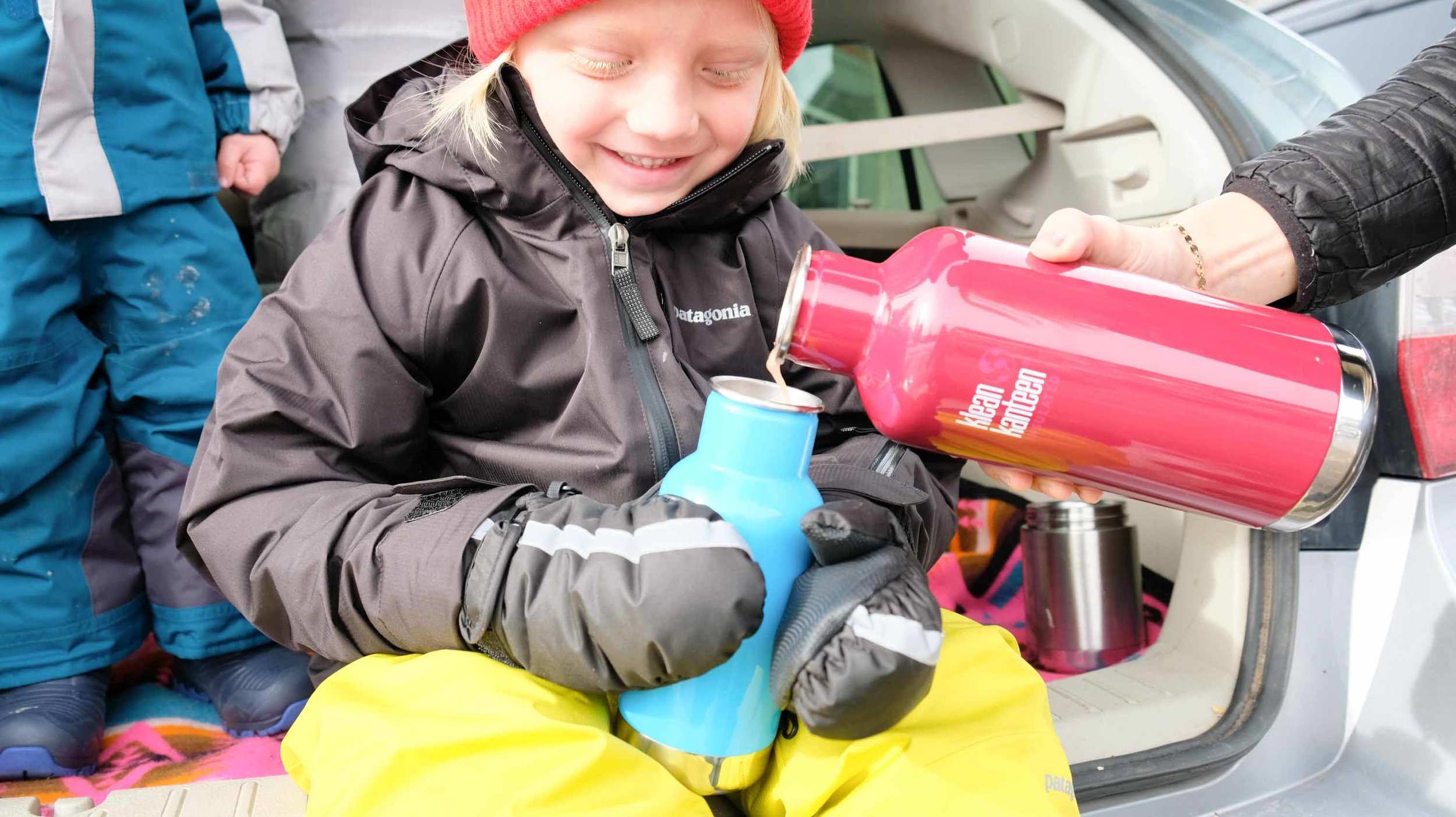Our friend, Hyde, refilling his cocoa on our hike at Silver Lake.