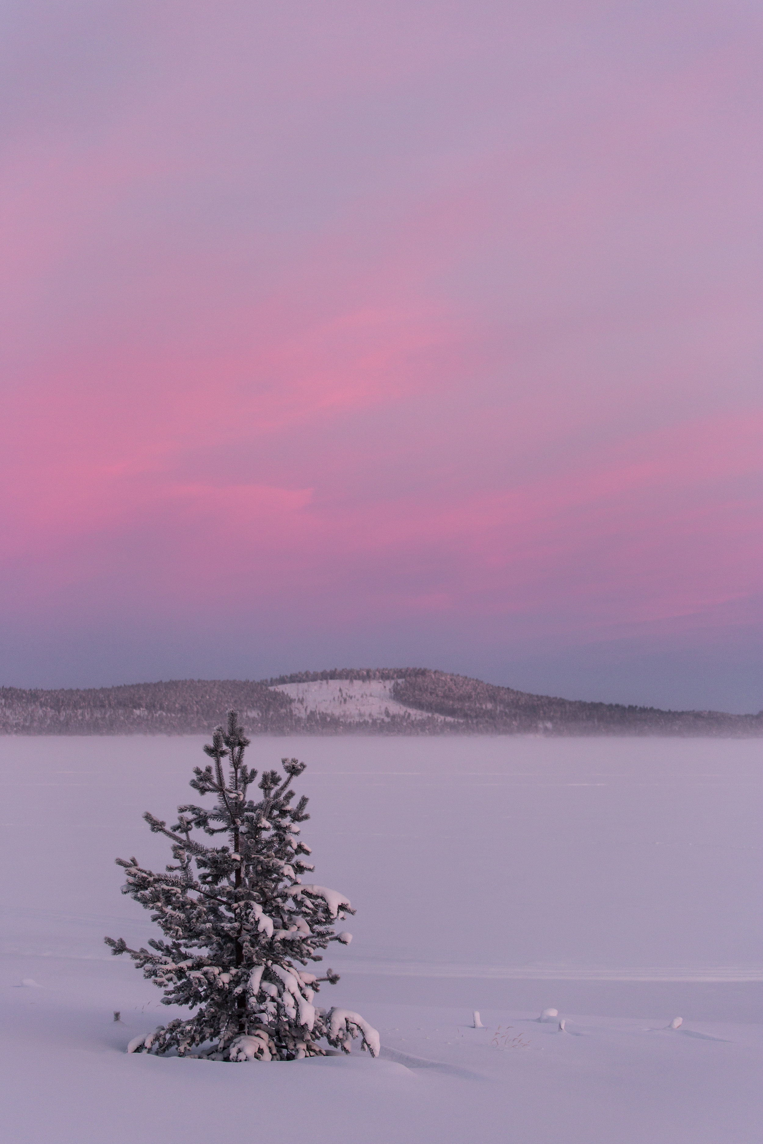 The landscape blanketed with snow, whilst the high cloud accentuates the Polar colour palette.