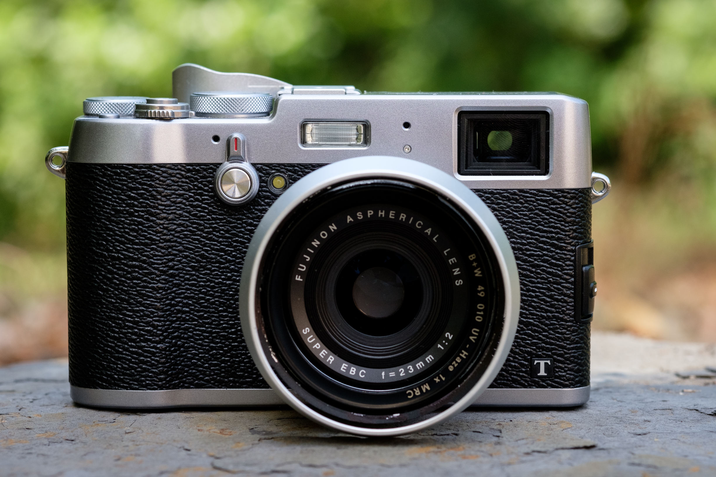The Fujifilm X100T. This has the exact same sensor as the X-T1 so the image quality is the same. This has a fixed 23mm f/2 lens and is very small. This is an excellent travel camera and very fun to use.