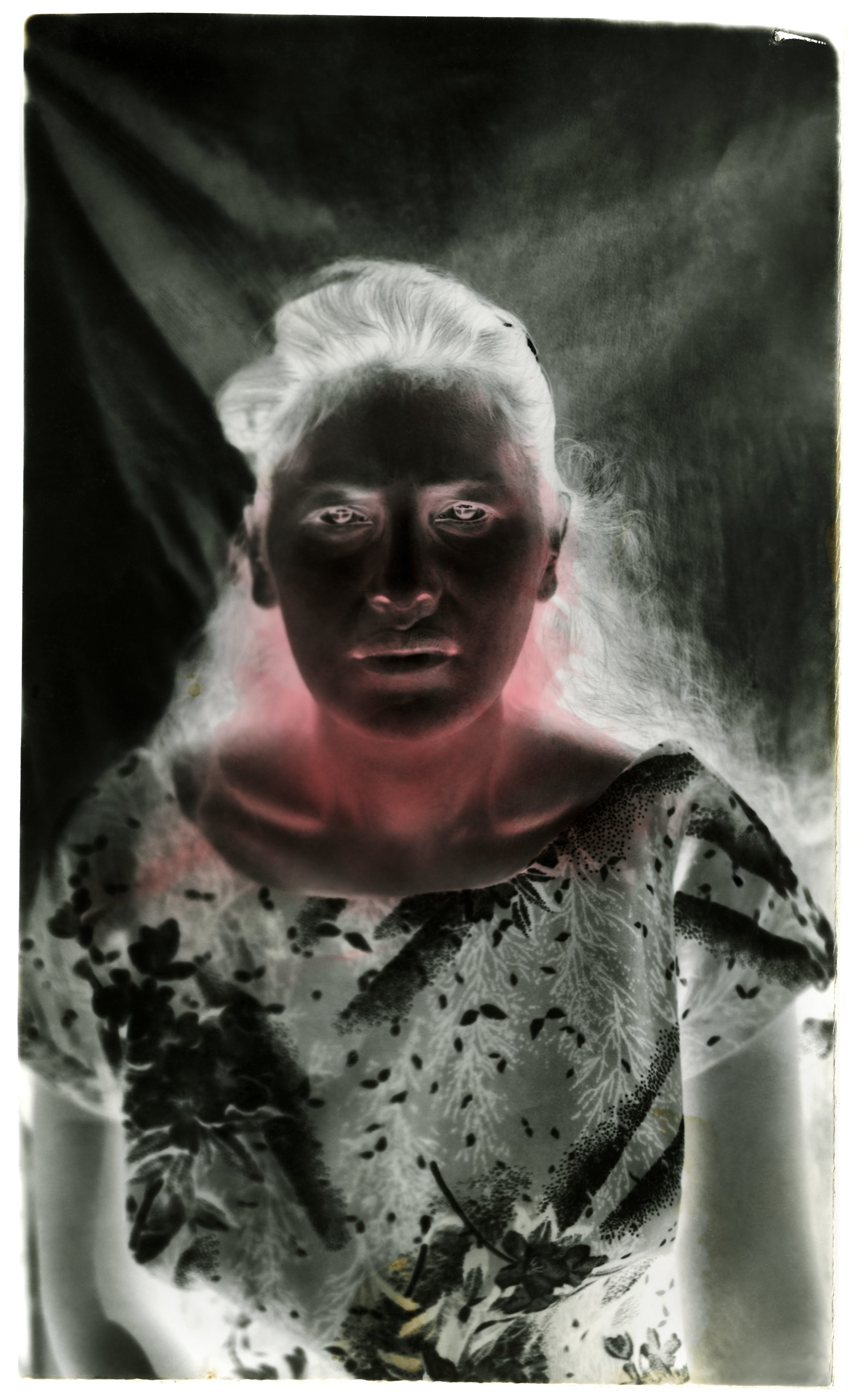 Under the Black Sun.  Hand-painted toned gelatin silver print, Mercurochrome. Variable dimensions.
