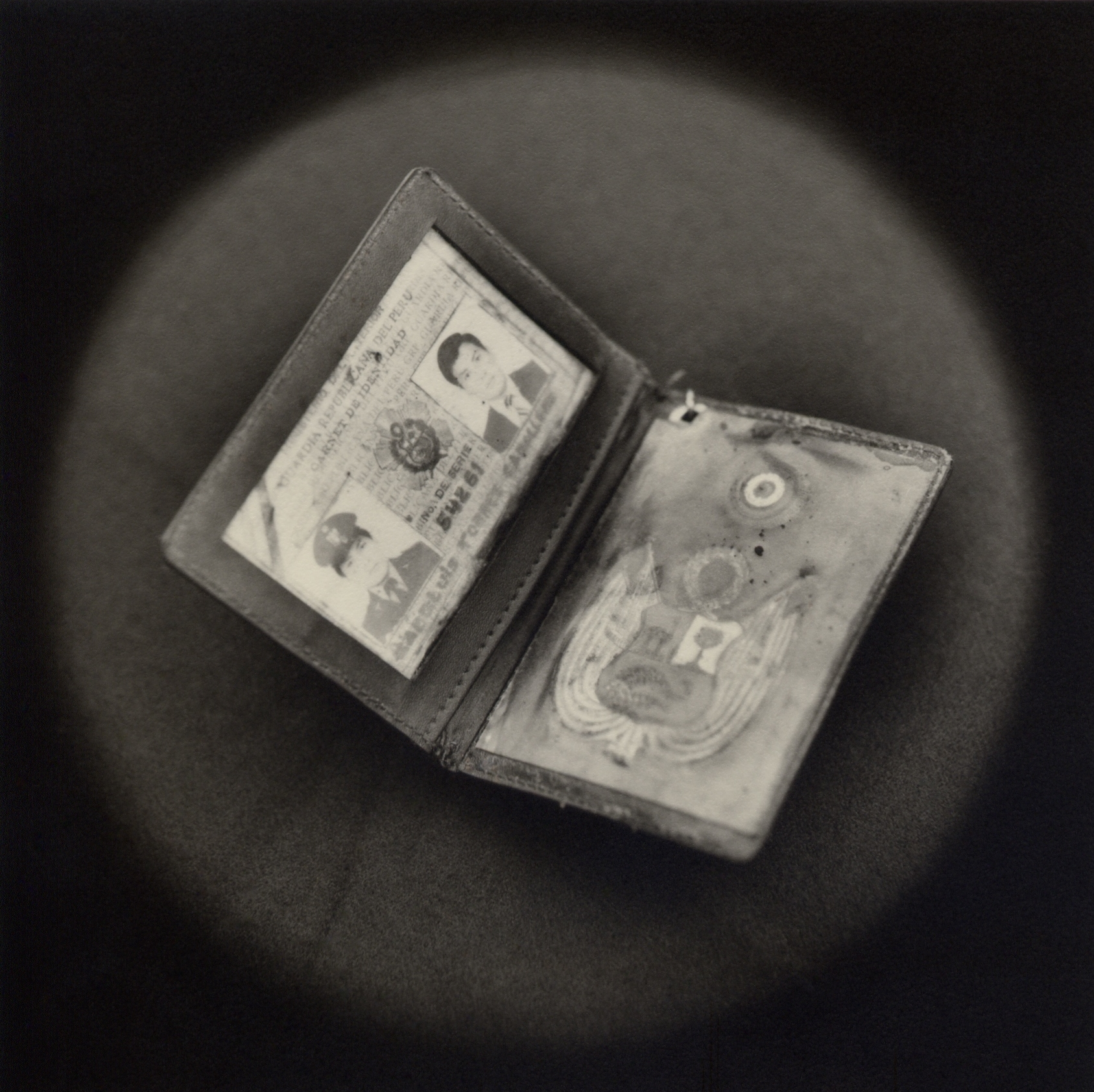 The Lost Steps (Fake police ID used by terrorist)  Toned gelatin silver print. 16 x 16 in.