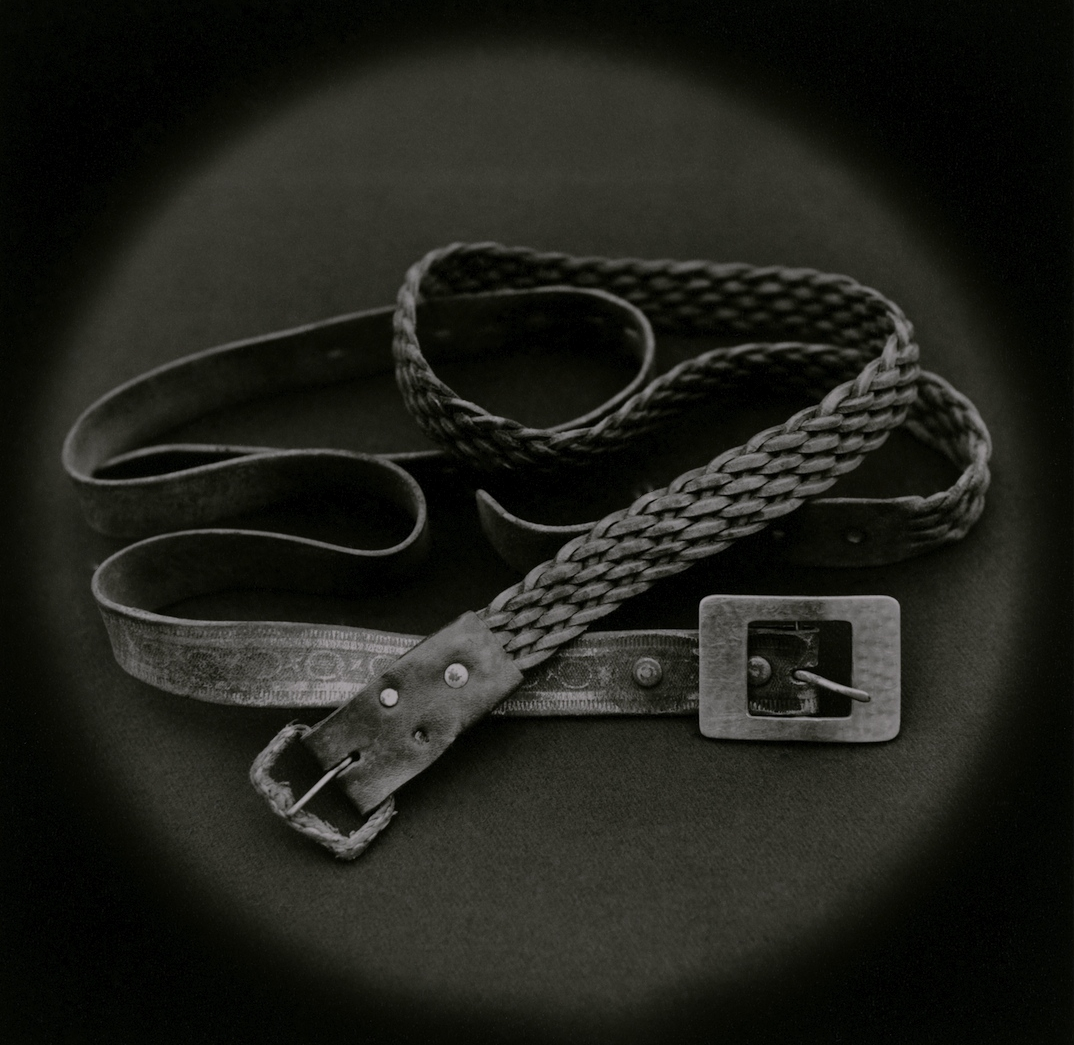 The Lost Steps (Belts used by psychologist Mario Poggi to strangle a rapist during police interrogation)  Toned gelatin silver print. 16 x 16 in.