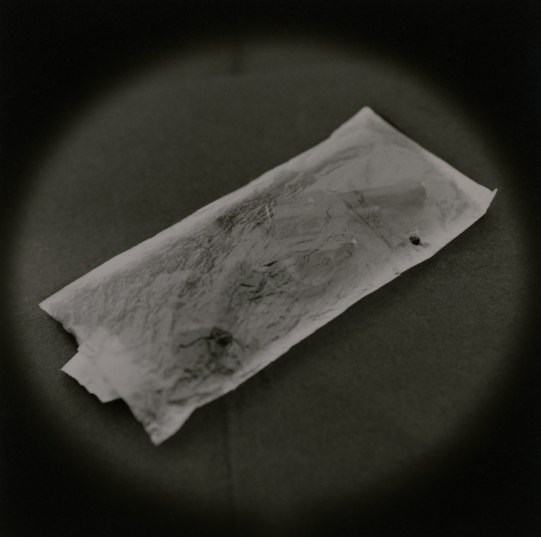 The Lost Steps (Handgun, incriminating evidence of murder)  Toned gelatin silver print. 16 x 16 in.