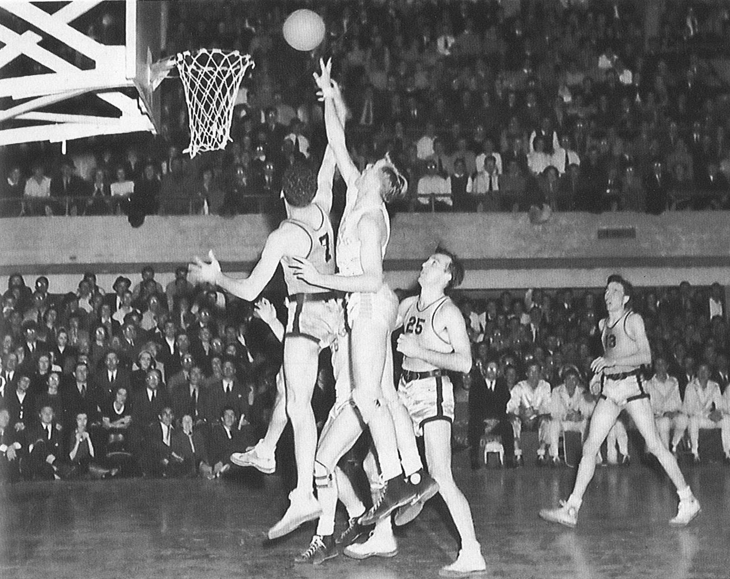 Cooley driving for the basket as a player with the UT Longhorn basketball team.