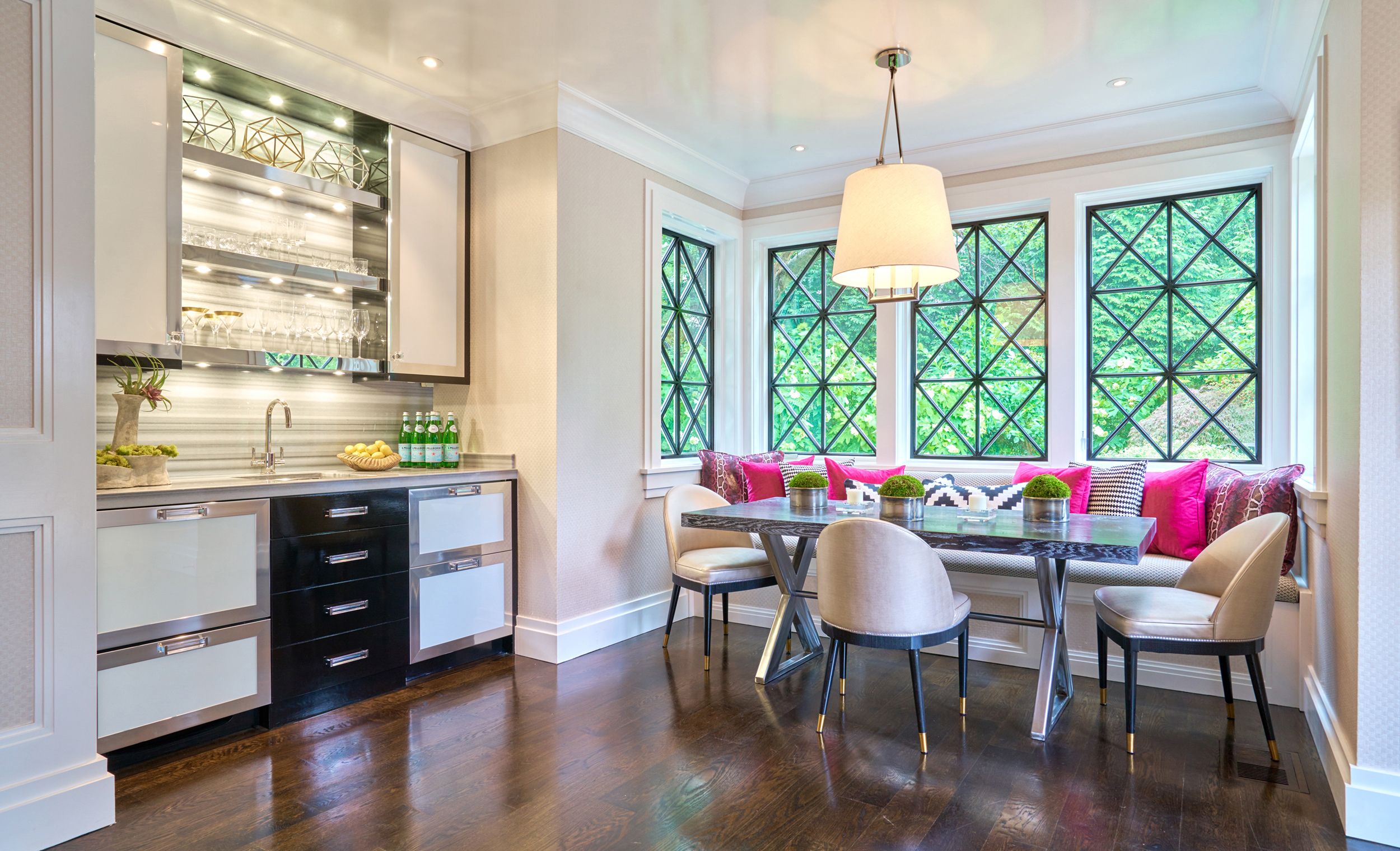 Intricate window designs define this alluring dining area.
