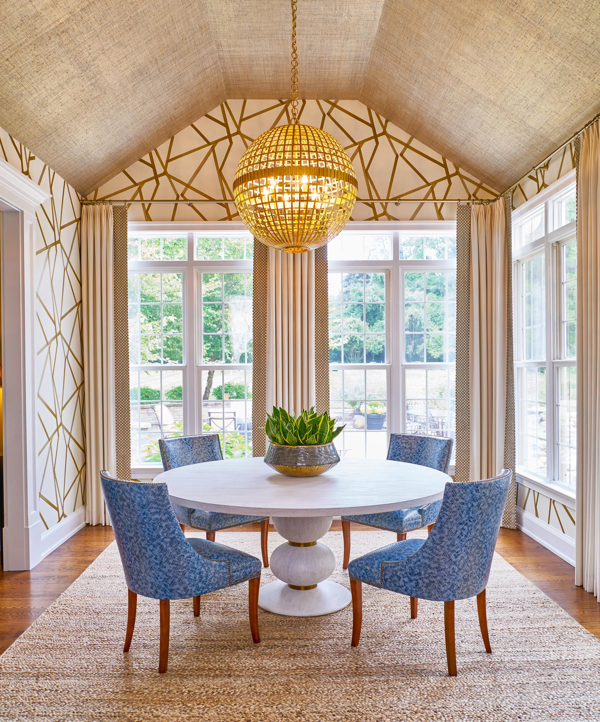 Striking wallpaper creates a modern morning room.