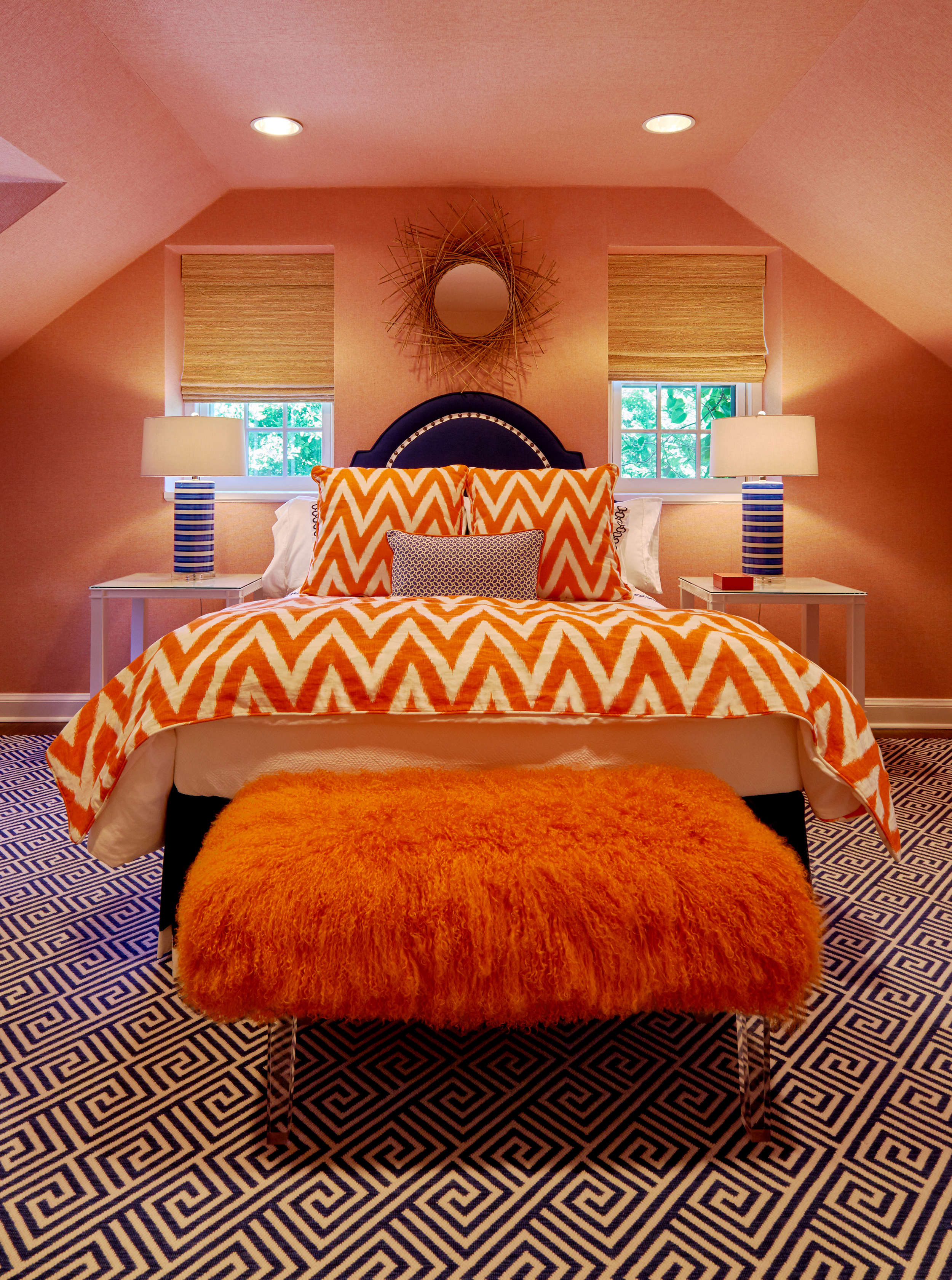 Furry bench on lucite adds texture to this inviting guest room.