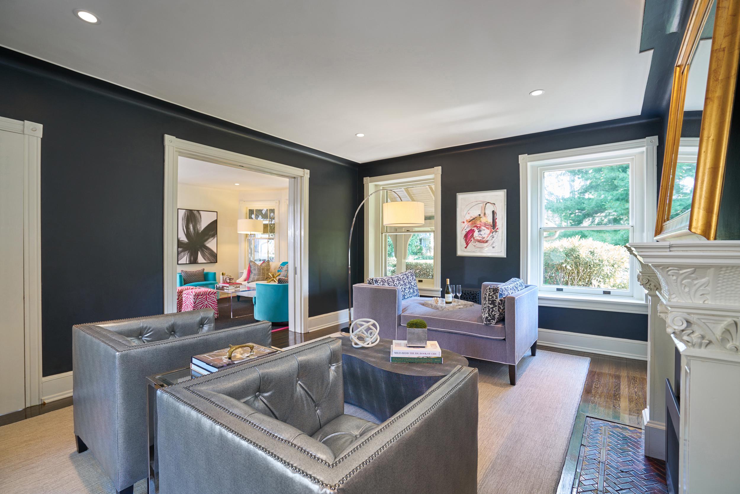 Black walls offset retro inspired furnishings.