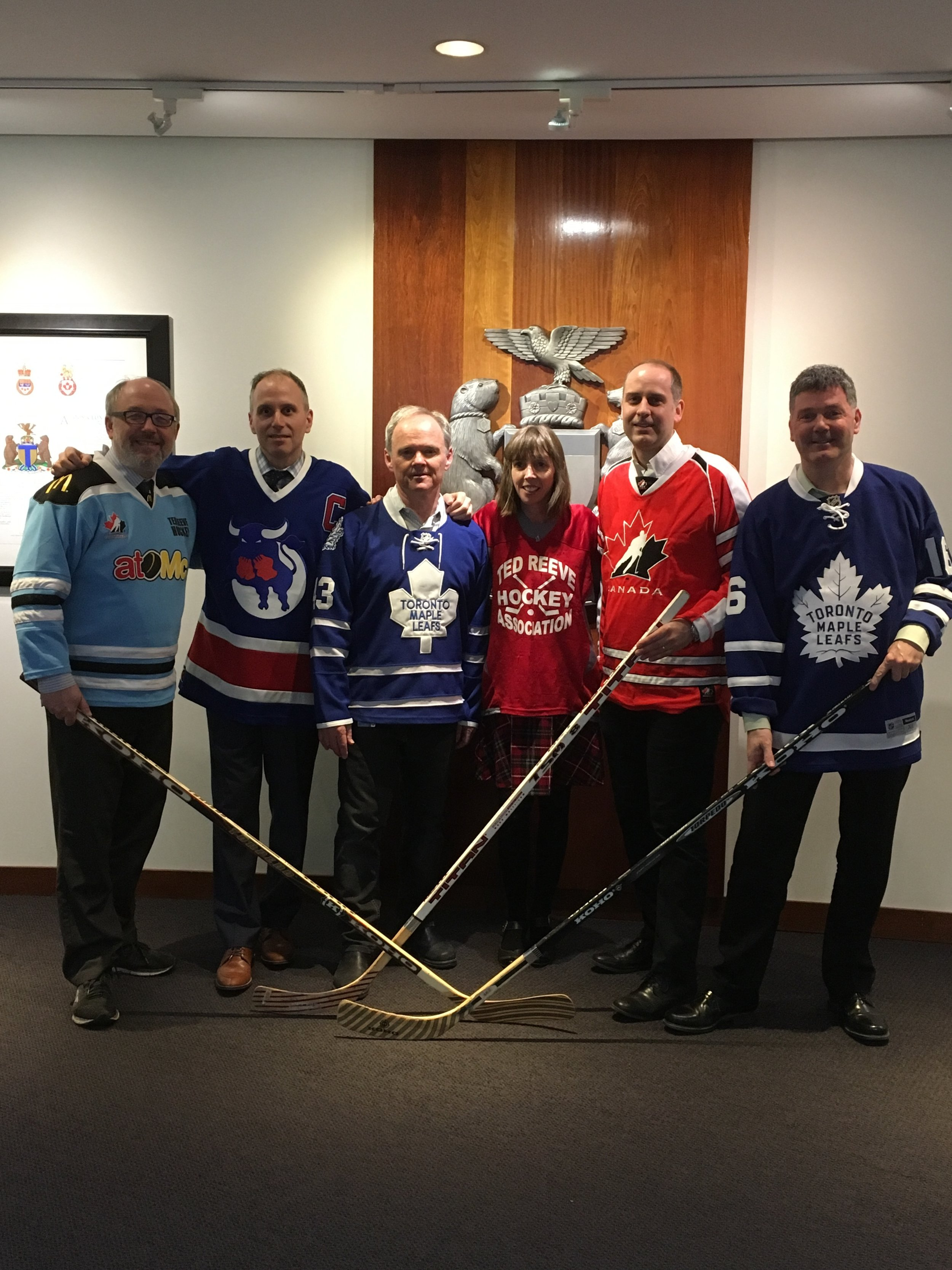City councillors wear hockey jerseys in honour of the Humboldt Broncos L-R: Joe Mihevc, Josh Colle, John Campbell, Mary Margaret McMahon, Stephen Holyday and Glenn De Baeremaeker