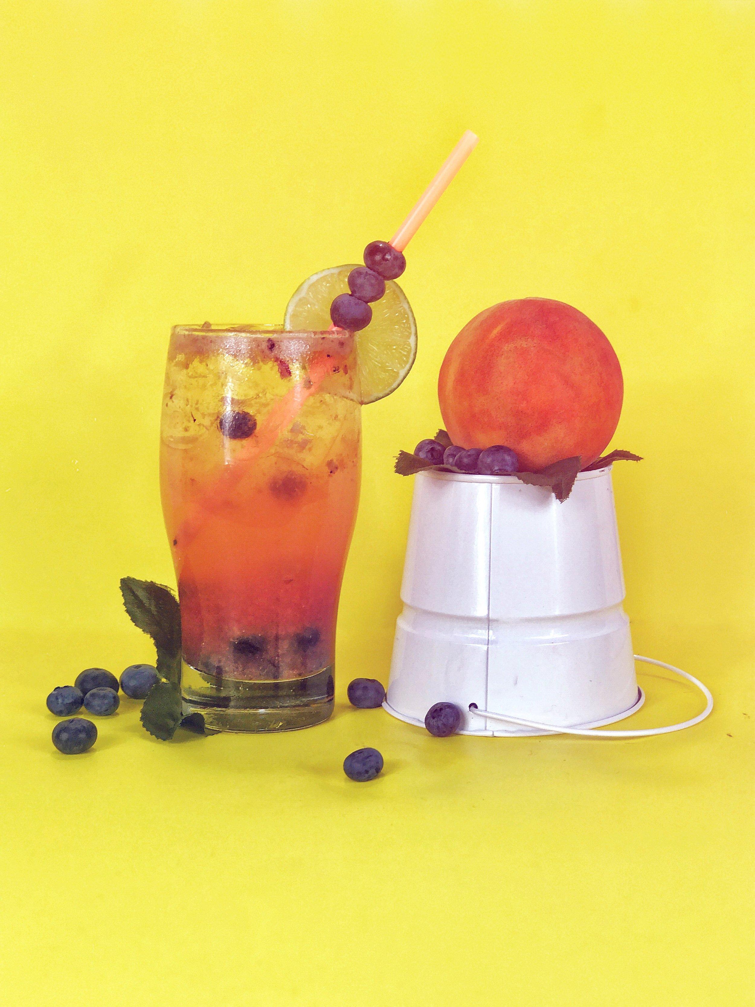 Peach-blueberrybourbon fizz - 1. Muddle blueberry and peach.2. Add bourbon (2oz), lime juice (2oz), egg white (1/2oz), and simple syrup (1/2 oz). 3. Shake hard w/ ice. 4. Top with soda. 5. Garnish w/ cherry (if ya like!).