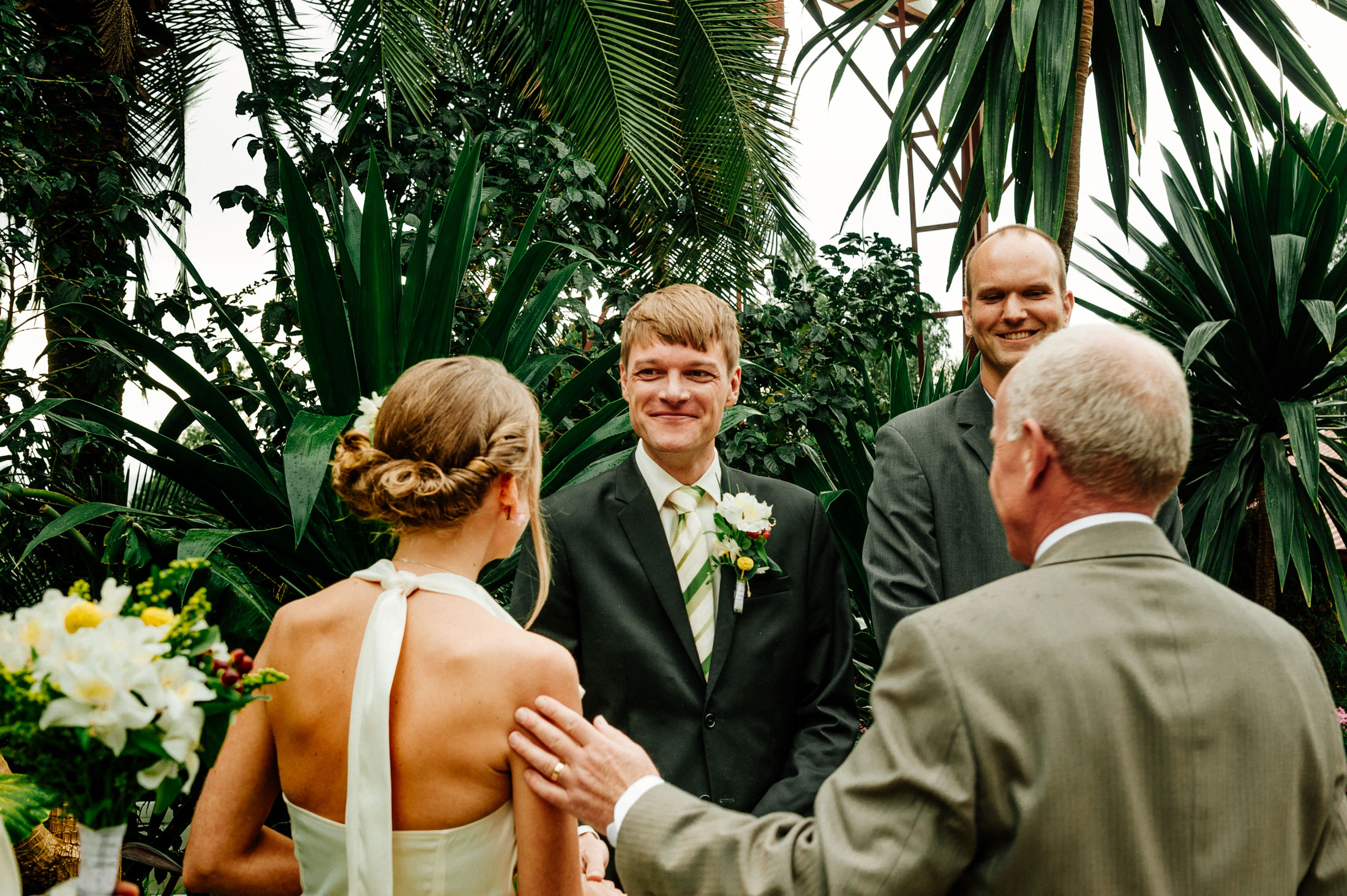Bride meets her groom at the altar with her father backyard garden ceremony in Addis Ababa; photographed by Northern California Offbeat Wedding photographer Kate Donaldson Photography.