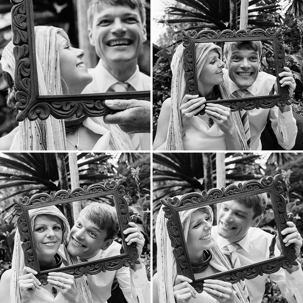 Bride and groom posing with a ceremonial frame by Arcata, California wedding and portrait photographer Kate Donaldson Photography