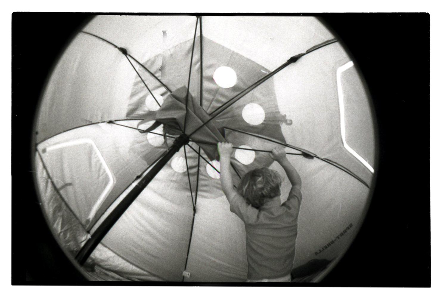 Cy Under a Beach Umbrella (Fisheye), 2012