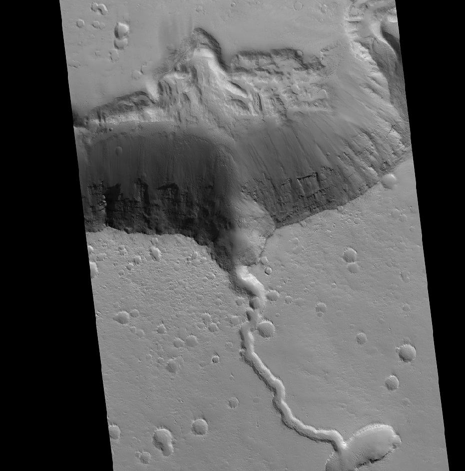 A solidified lava flow over the side of a crater rim of Elysium. Credit: NASA HiRISE image, compliments of David Susko.