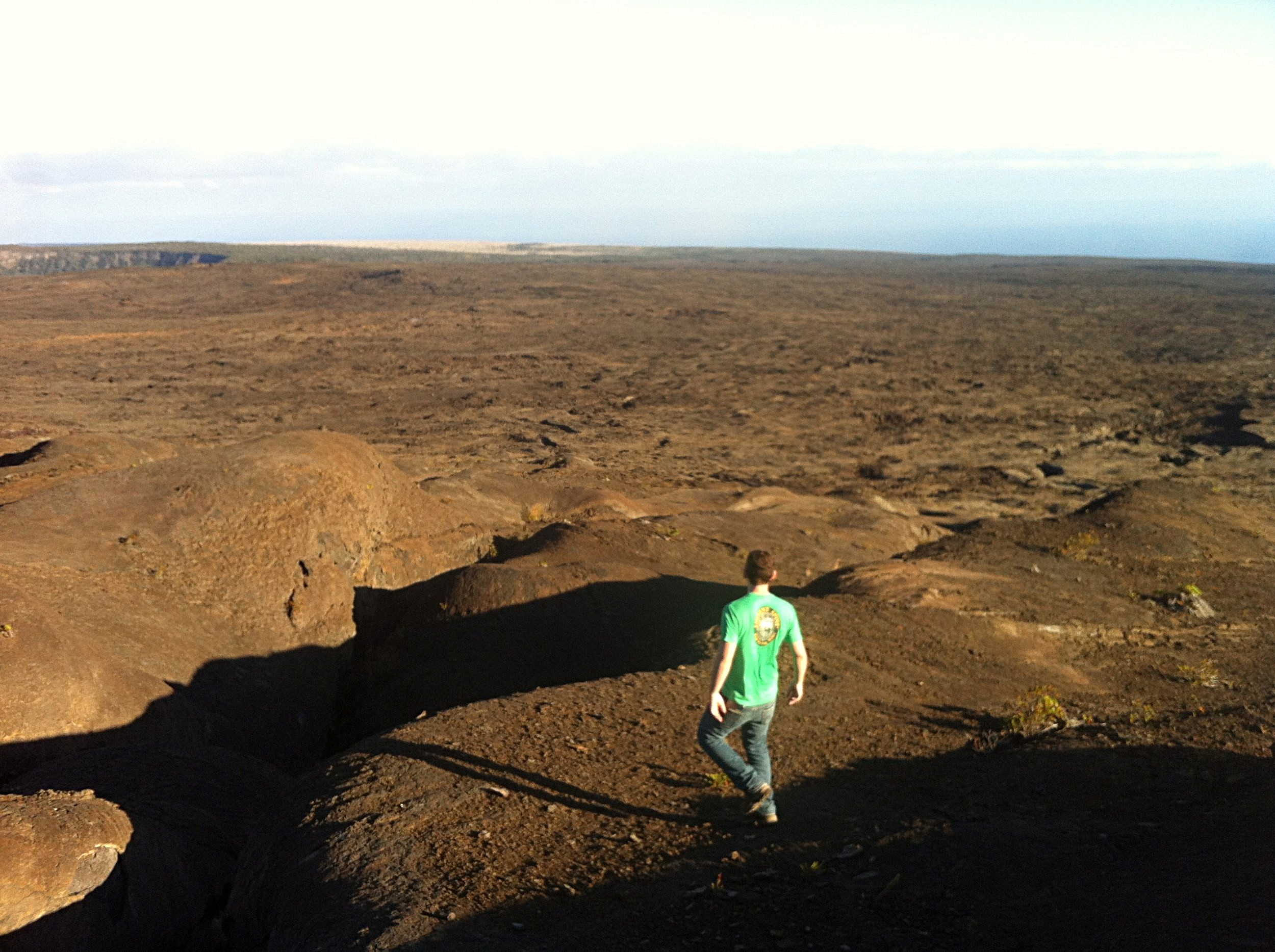 David Susko walks on lava flows in Hawaii. The Planetary Science Lab group at LSU has worked in Hawaii to collect samples that could be analyzed in a laboratory setting and compared with the rocks in the Elysium Volcanic Province on Mars.