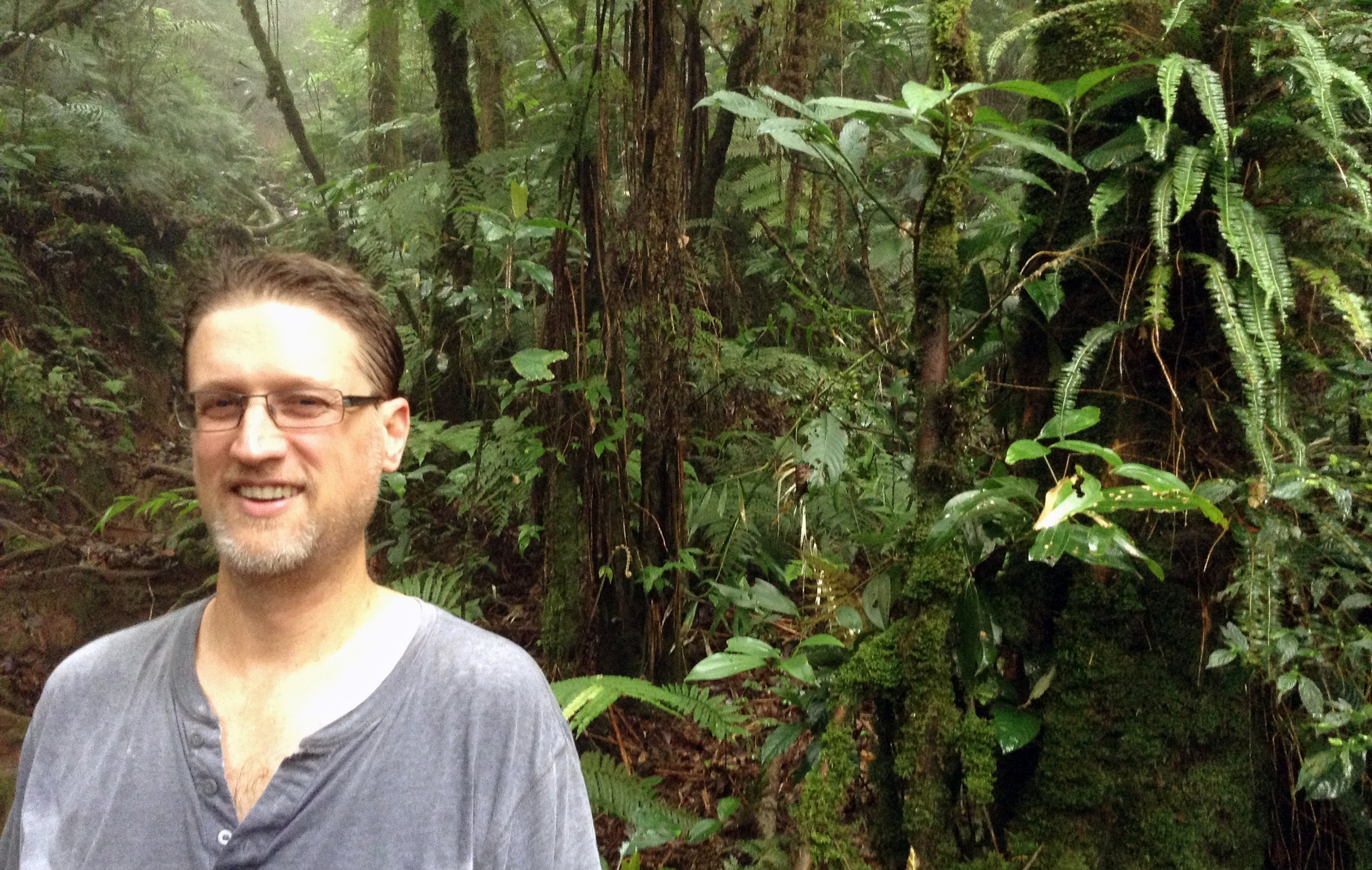 Photo of Jake Esselstyn at a field site in the mountains of Sulawesi.