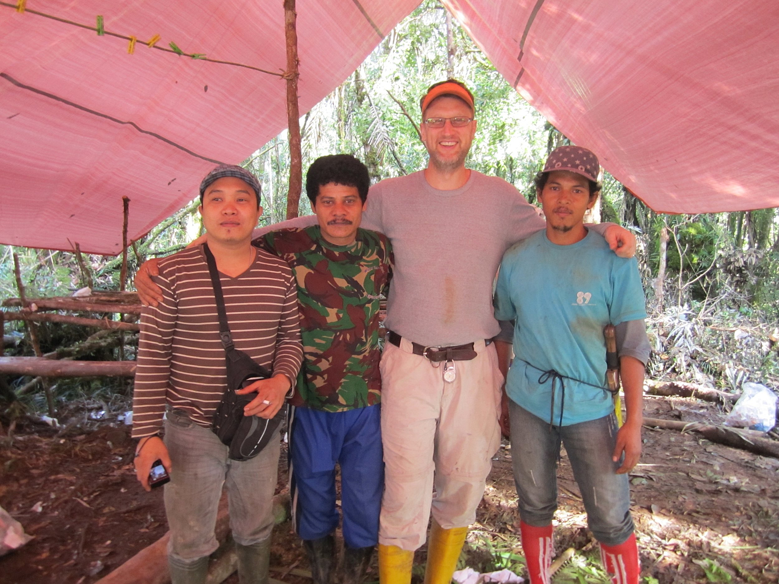 Photo of Esselstyn (center) with local guides and field assistants.