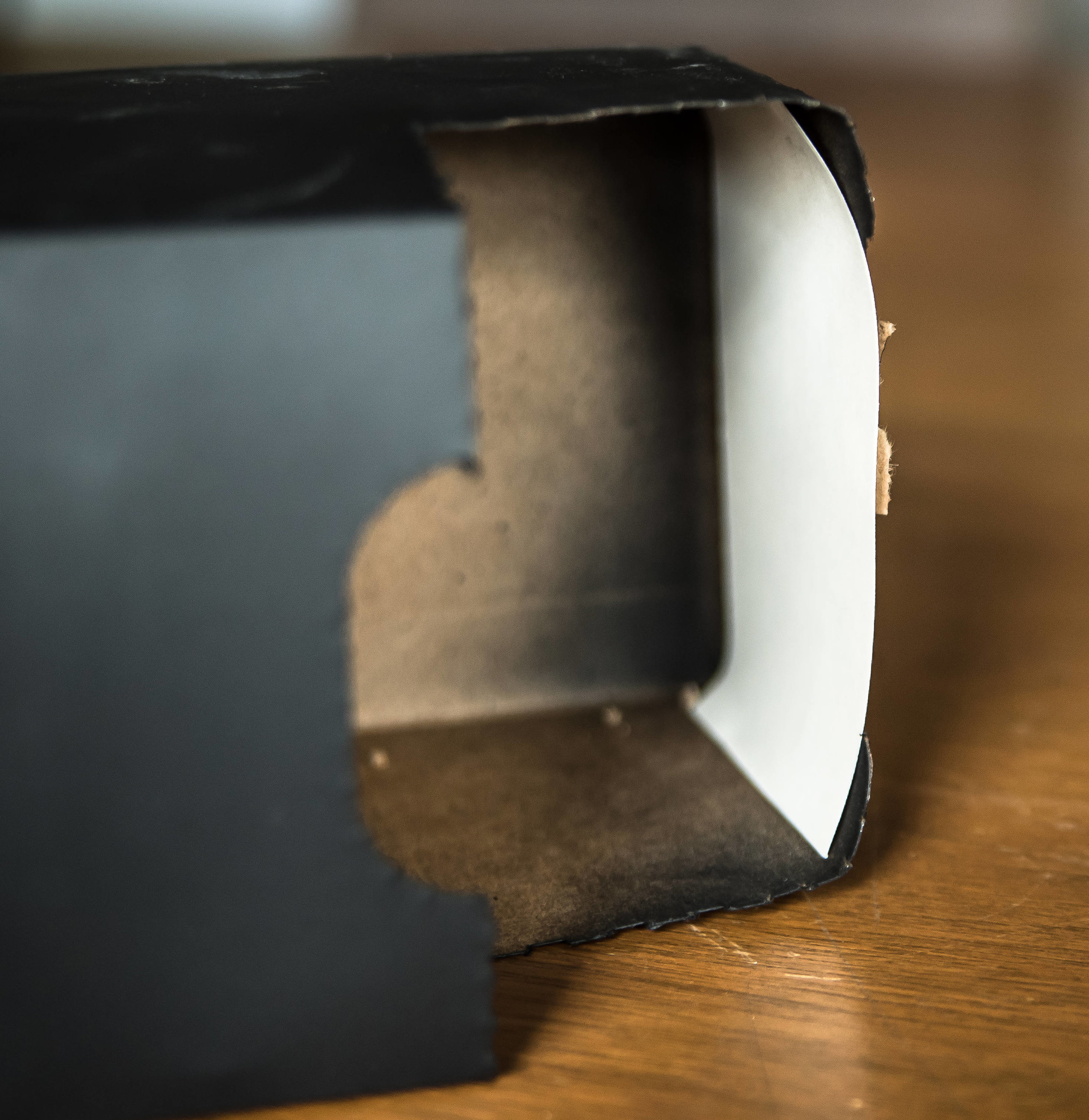 In the space where the soda box tears open, cut a piece of white paper to fit along the bottom. The sun will appear here!