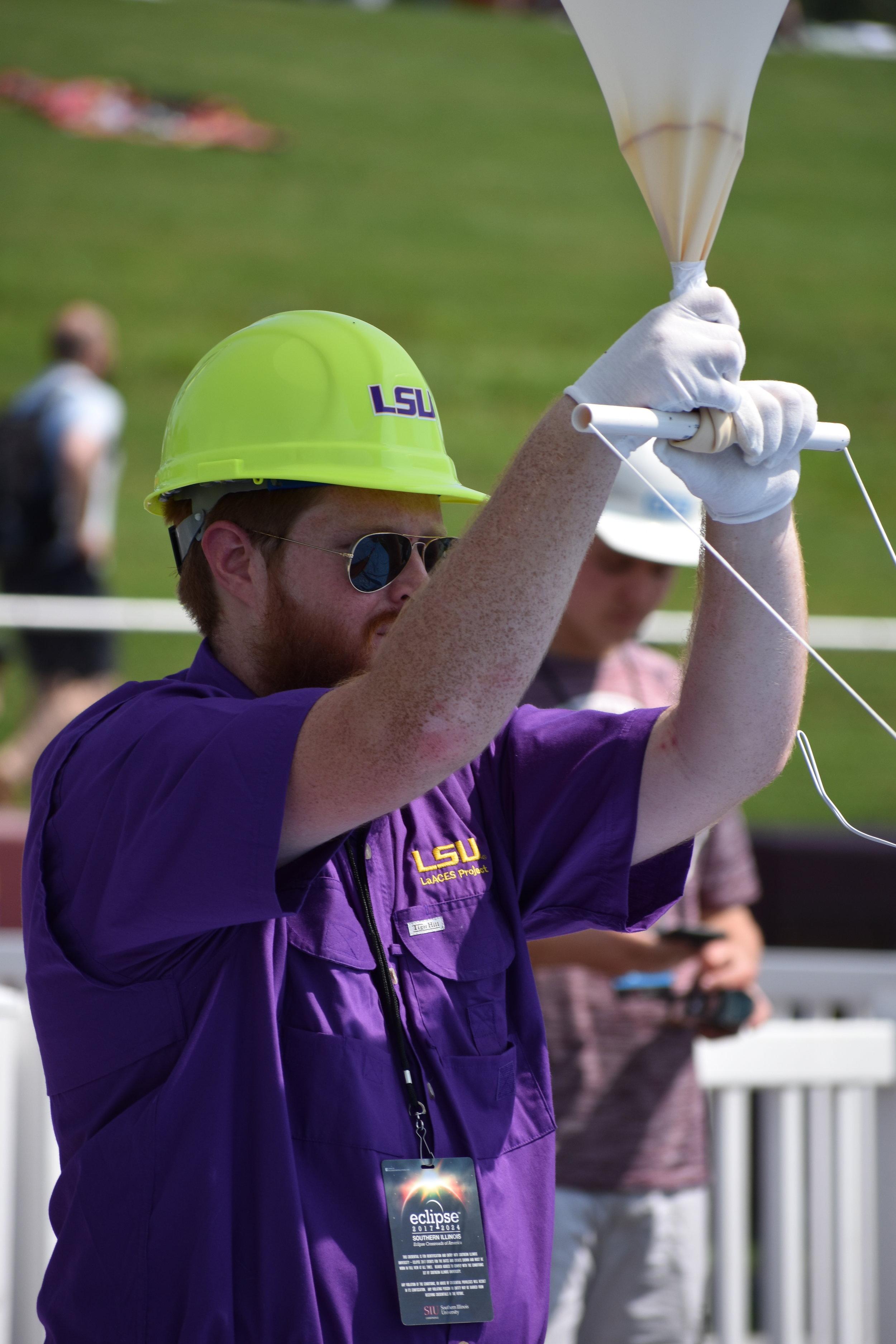 Brad Landry holds the eclipse balloon
