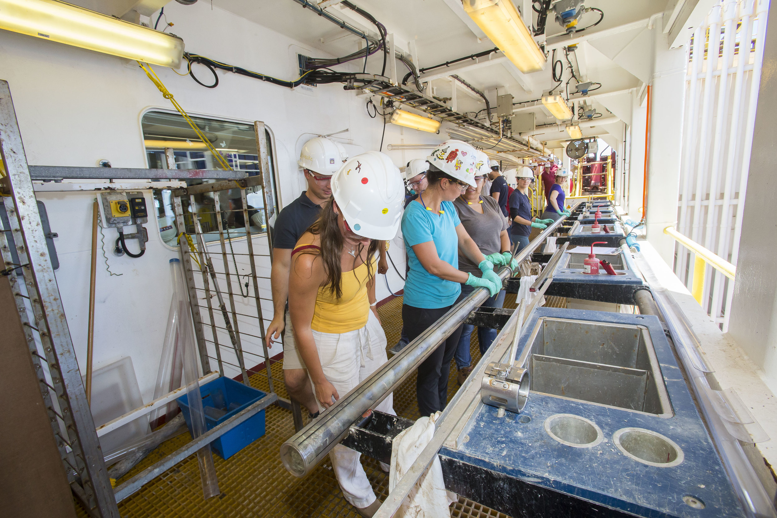 Core arriving at the catwalk for sample preparation and analysis. Photo credit: Tim Fulton, IODP.