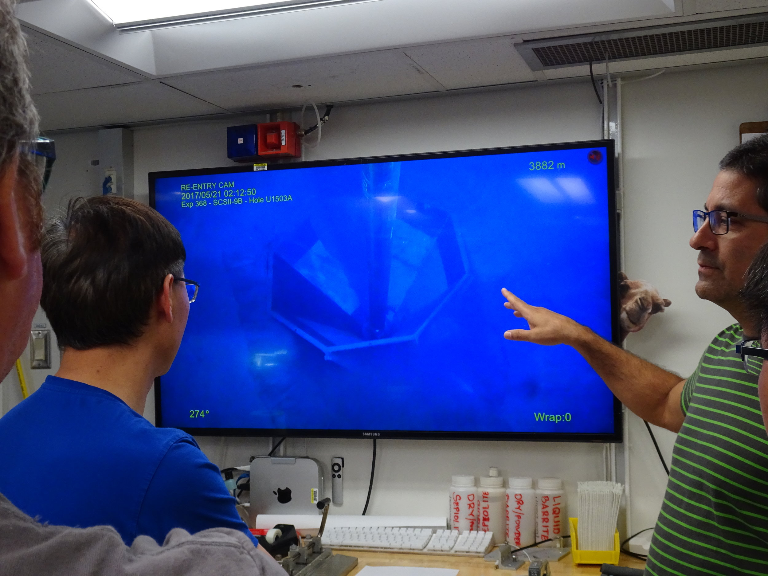 Scientists watching the camera of the sea floor. Photo credit: Froukje van der Zwan, IODP.
