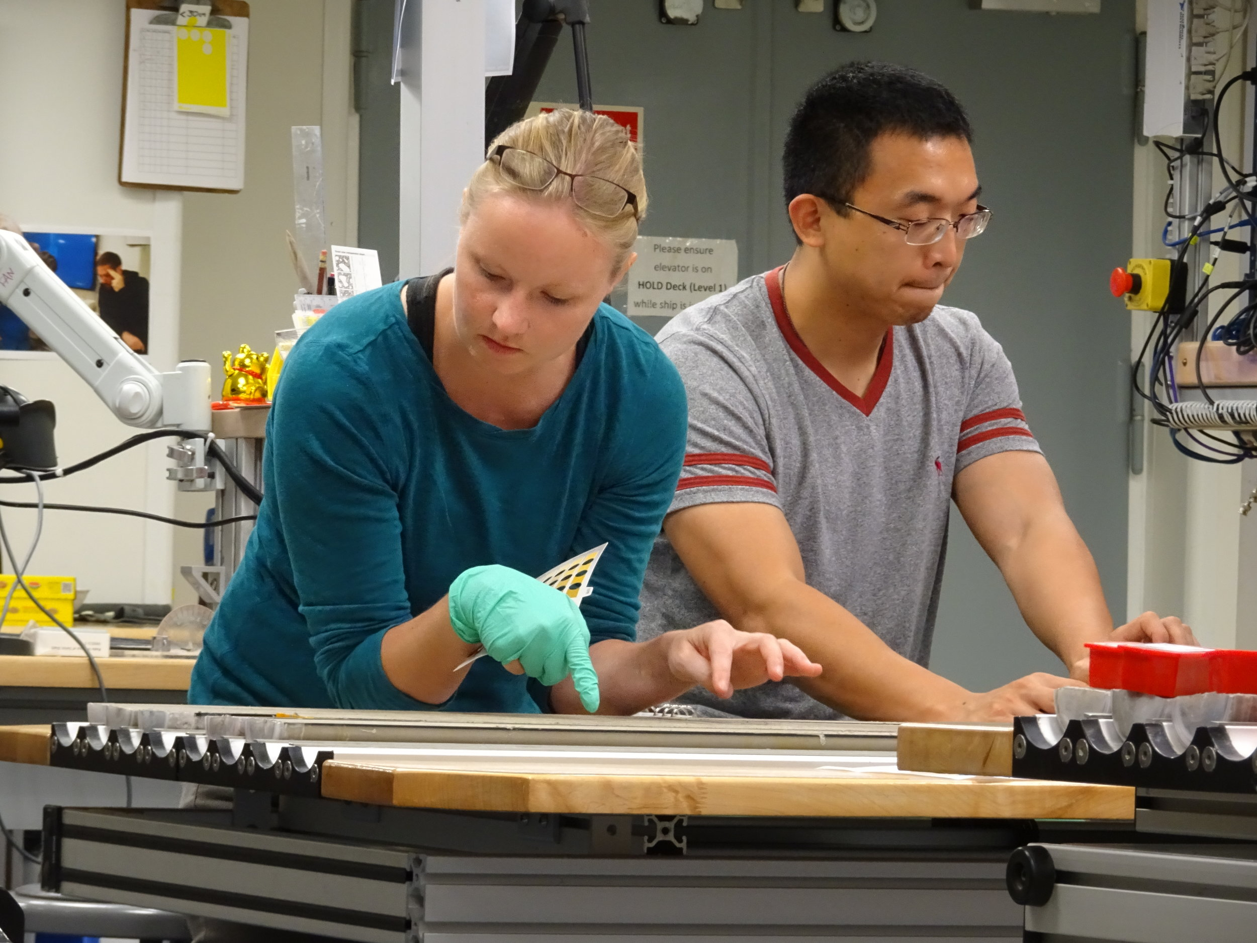 Dr. Julie Schindlbeck and Chang Liu are describing cores from the sea floor. Photo credit: Froukje van der Zwan,IODP.