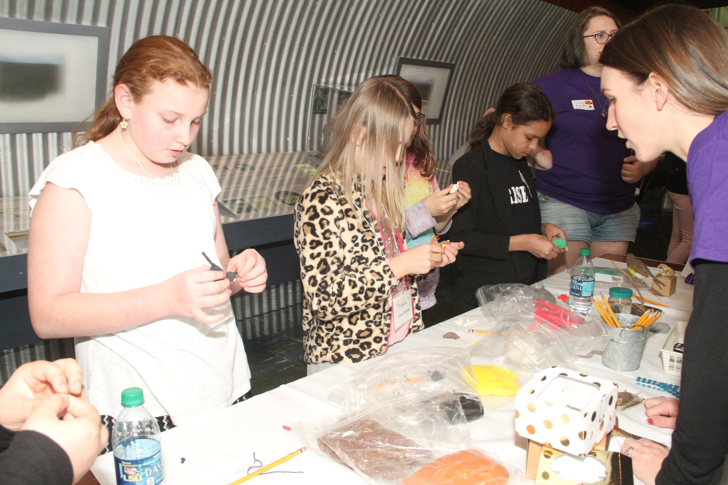 The girls made specimens out of clay and tagged them just like scientists in the LSU Museum of Natural Science at the Build-A-Specimen science activity station.