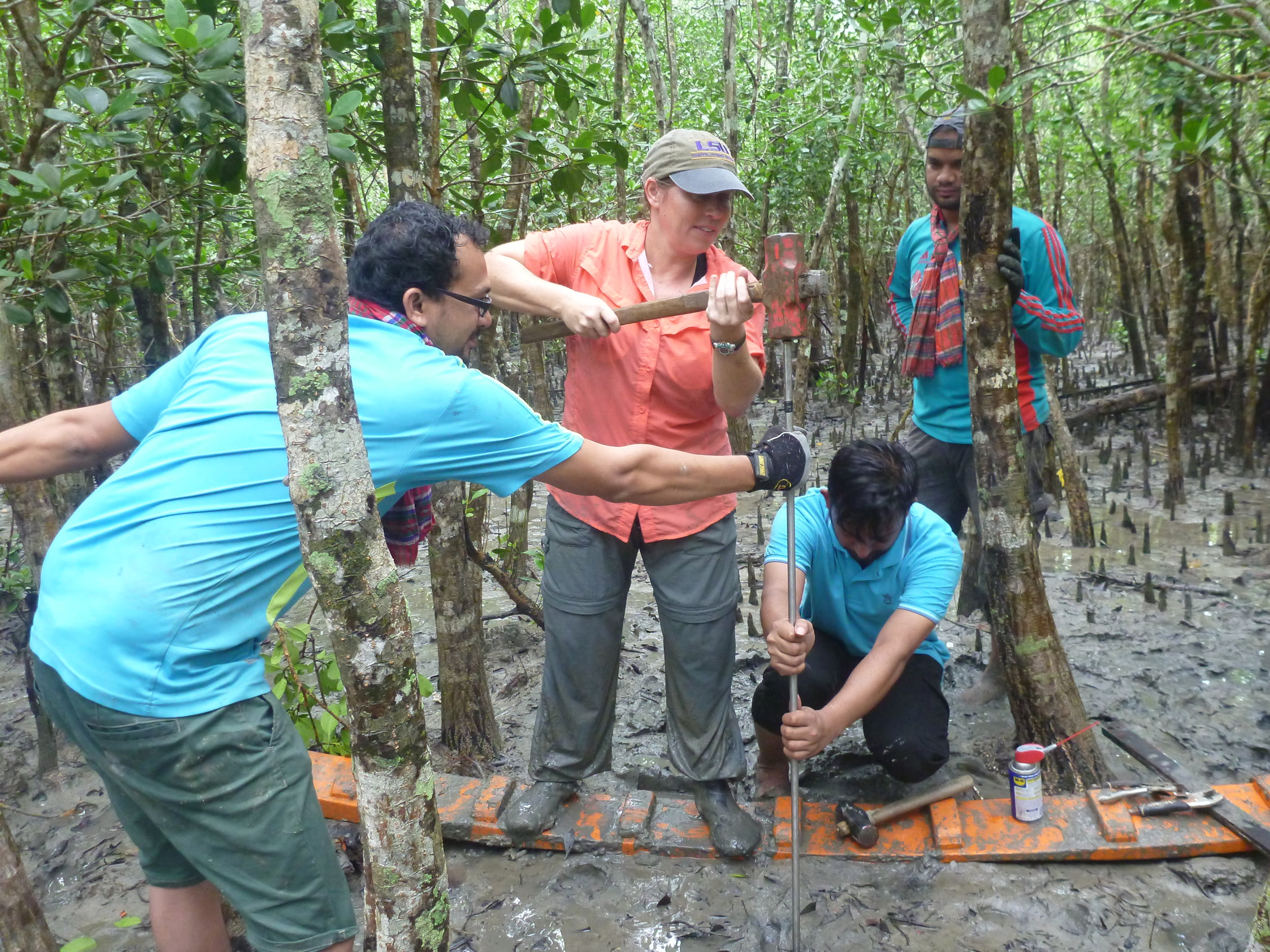 Dr. Carol Wilson during fieldwork trying to understand the dynamics of river delta systems.