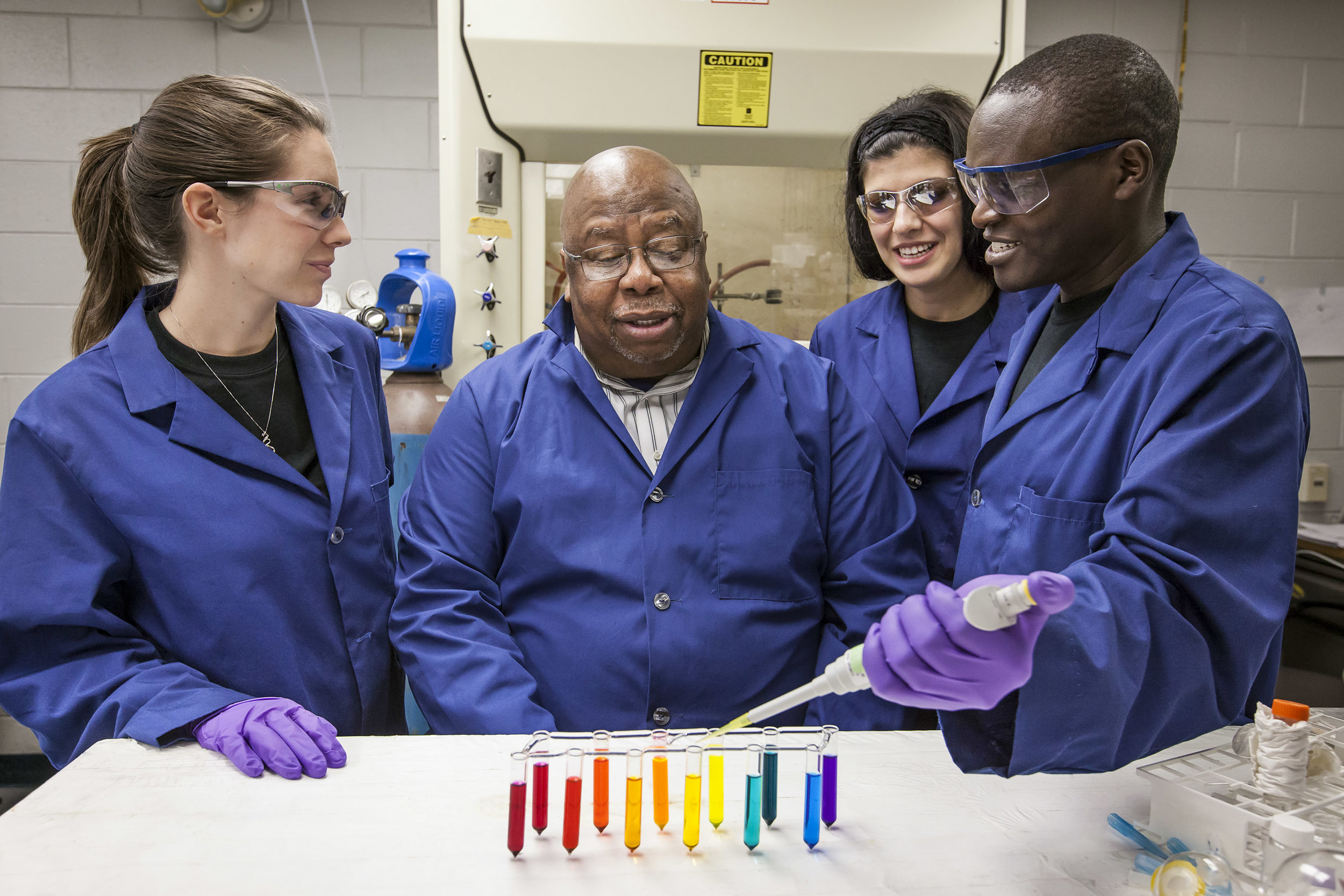 Dr. Isiah Warner working with his students Kelsey Mato, Dr. Suzana Hamdan and Dr. Paul Magut in his lab. Credit: LSU Office of Research and Economic Development.