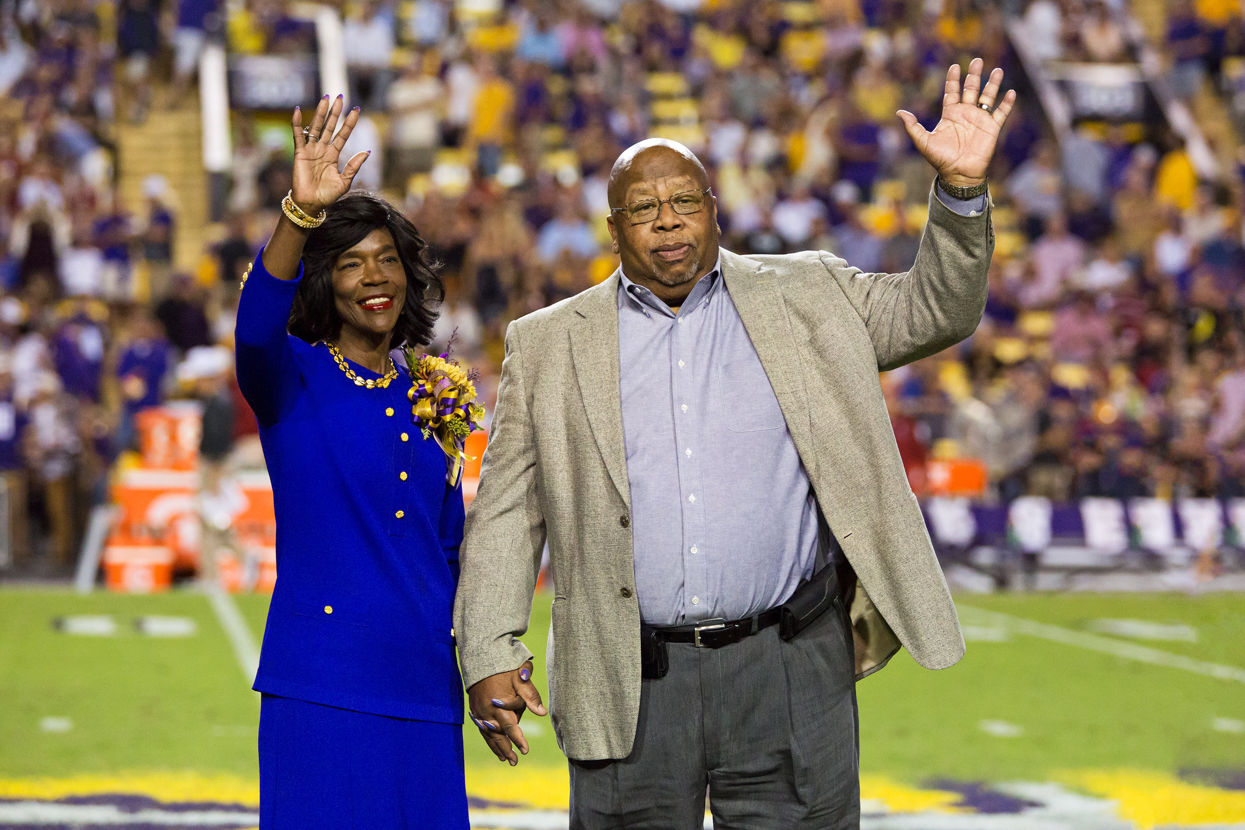 Dr. and Mrs. Warner on the field during halftime of an LSU football game when he was being recognized for his 2016 SEC Professor of the Year award. Credit: LSU