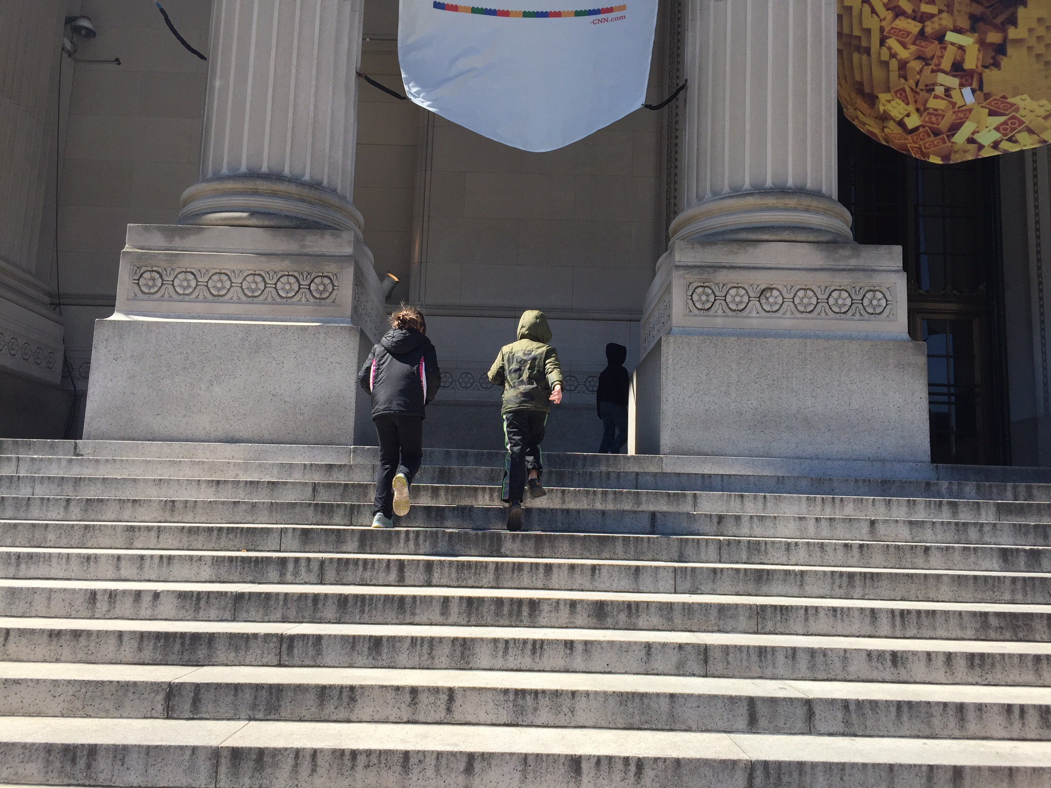 Running up the stairs of the Franklin Institute