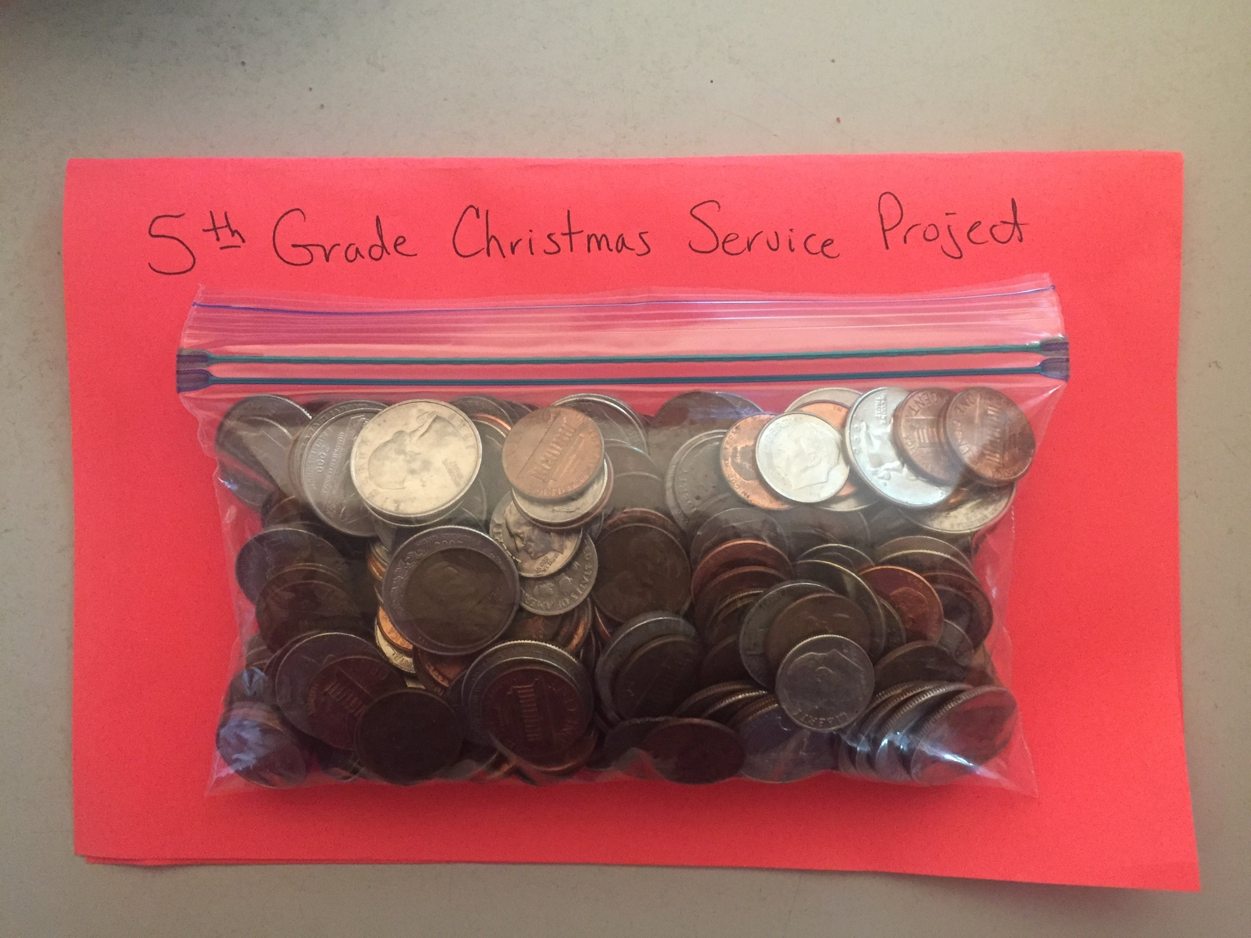 Day 24: Put your loose change in a charity box.