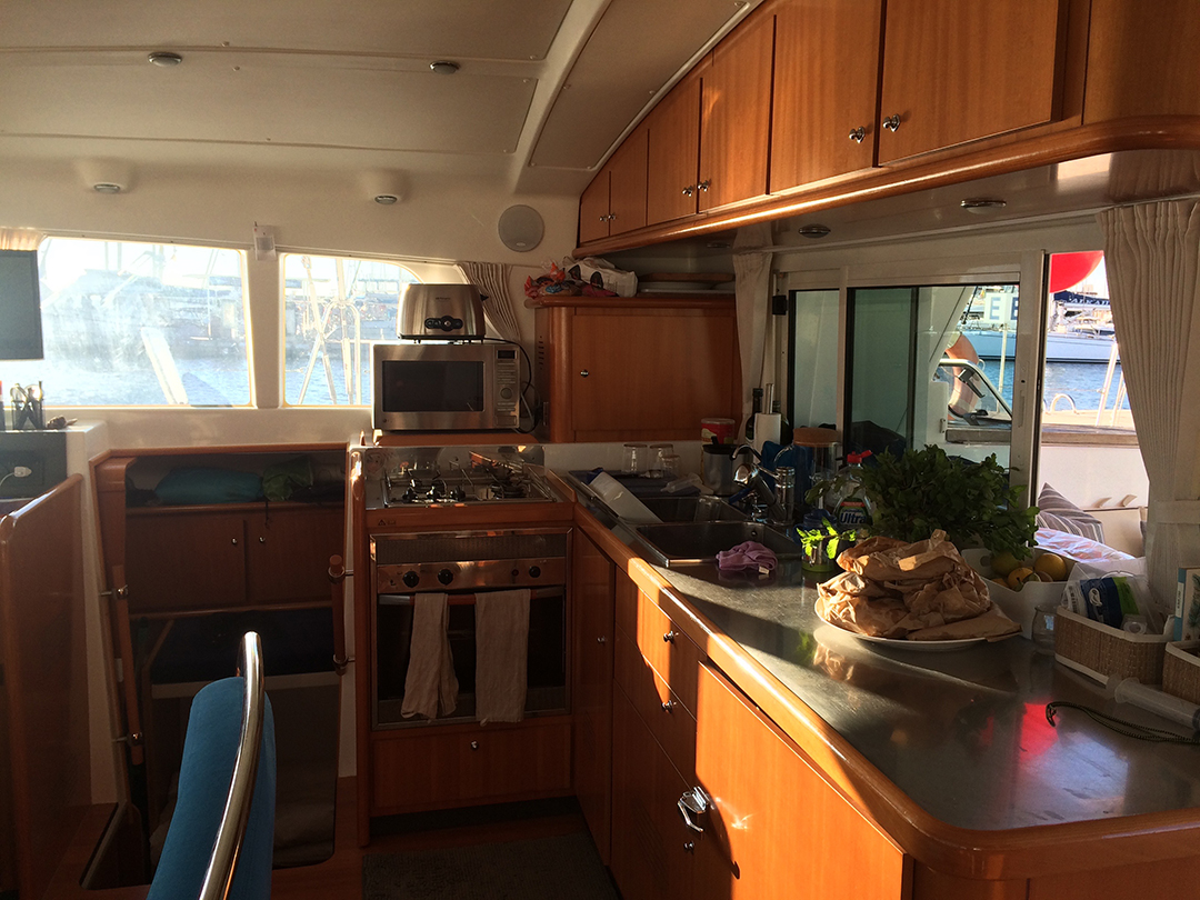 galley with stove, gas burners, 3 sinks, microwave, fridge, freezer and yup, running water!