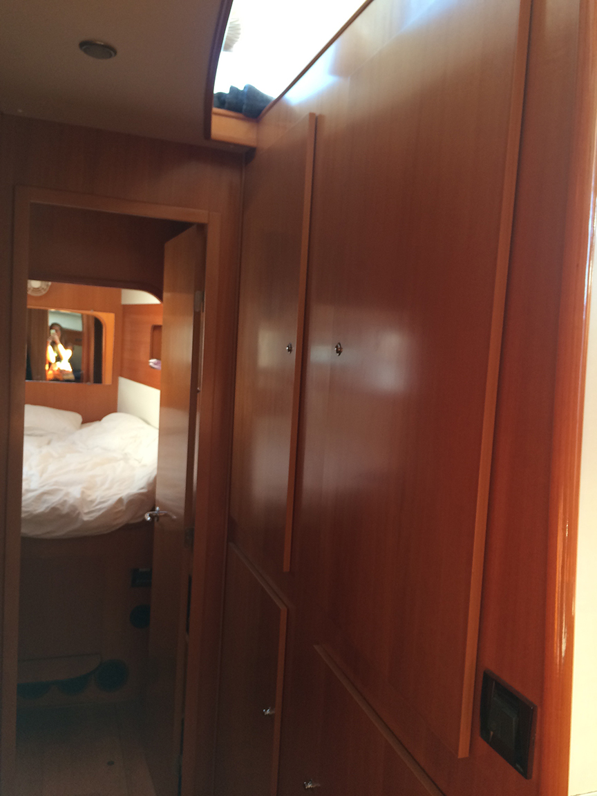 down 3 steps on the port side hull are 2 bedrooms and 2 heads [bathrooms] with a hallway full of storage in between. You can see Enzo's room ahead