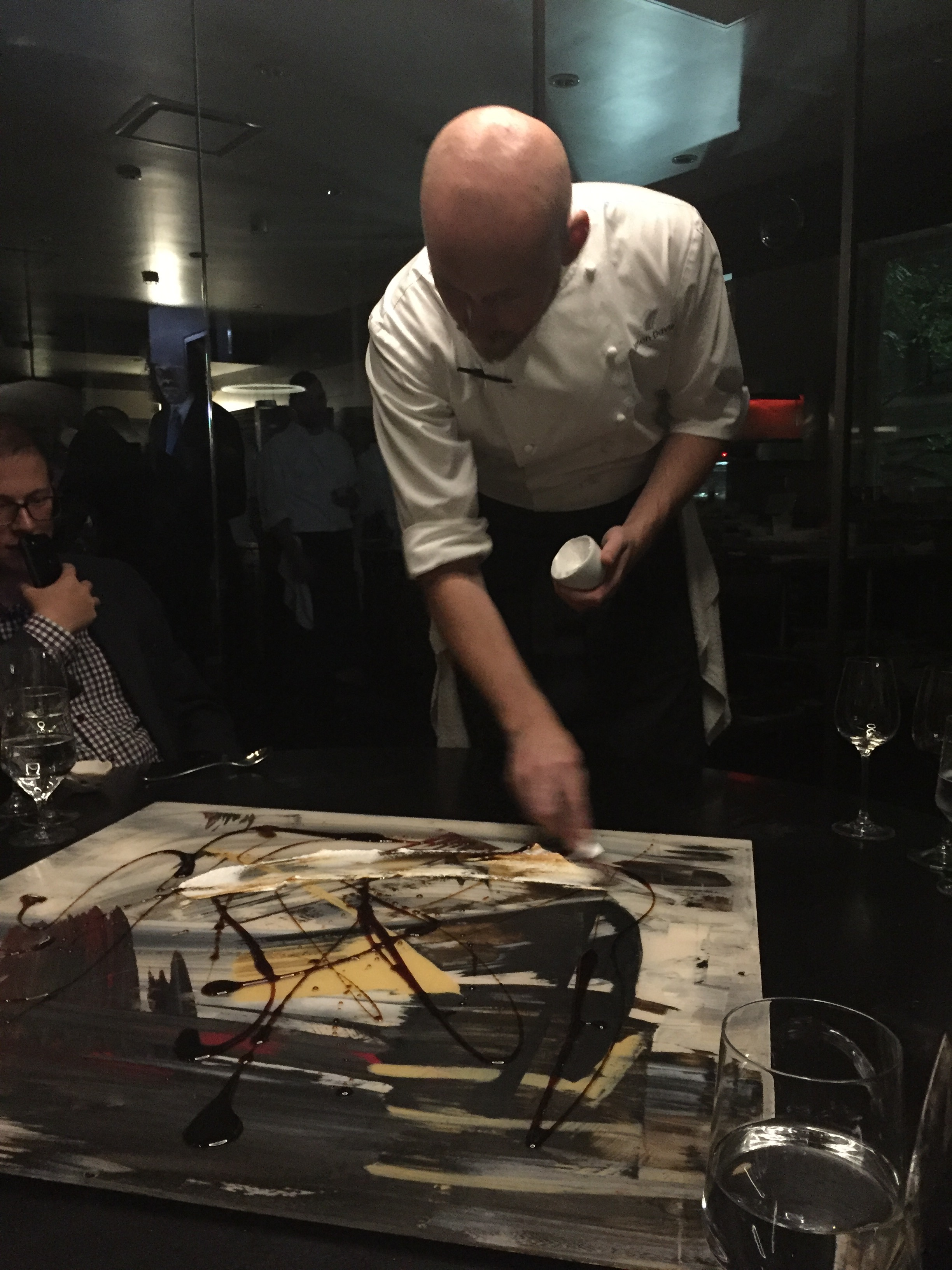 """Dessert course #2: When the lights suddenly turned off in the kitchen, music started bumping, they removed a piece of art hanging from the ceiling above our table,and used it as the foundation for the communal dessert the chefs then """"painted"""" for us."""