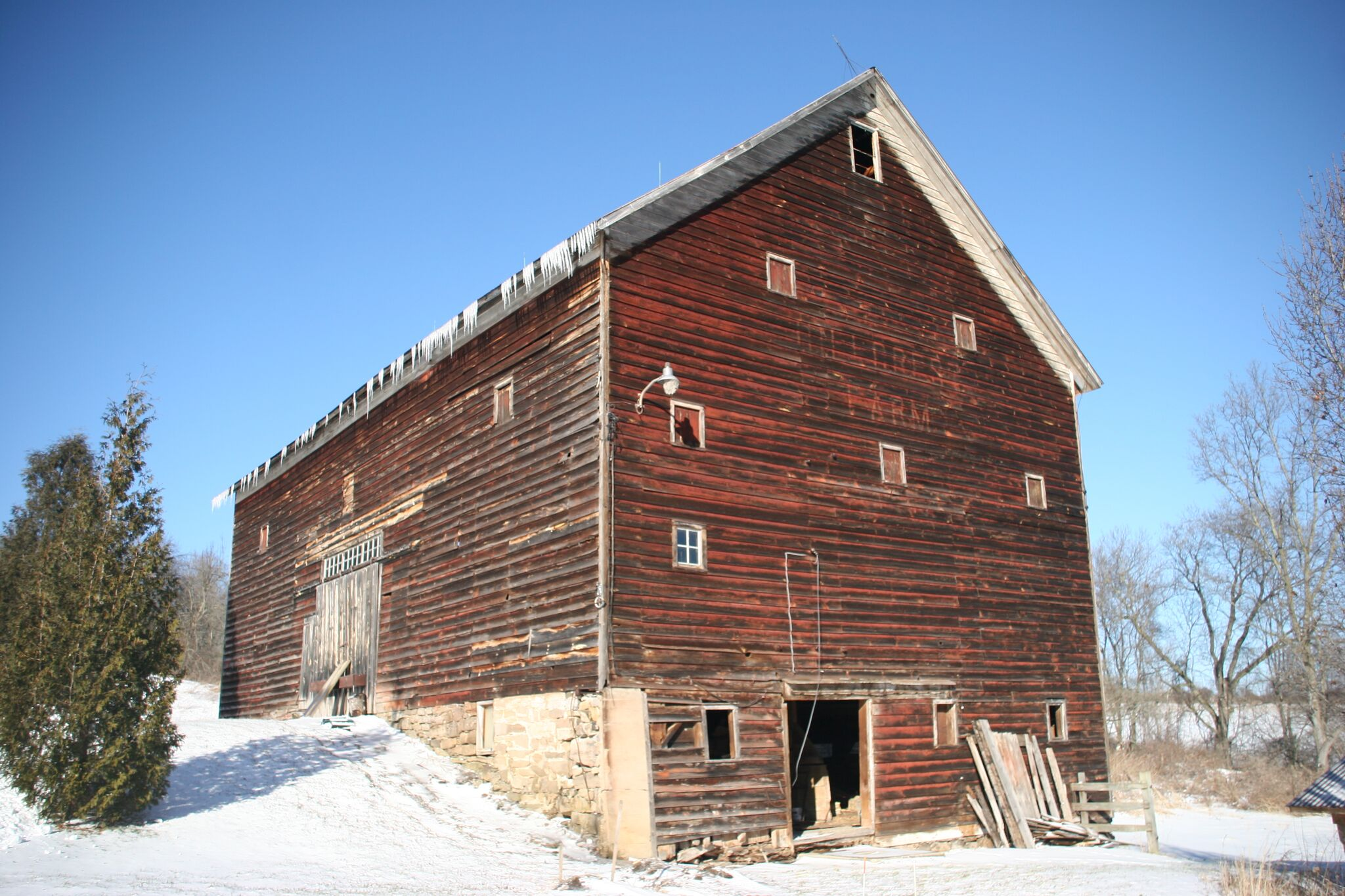 """Type:  Dutch Barn  Name: Hill Crest Farms Dimensions: 40' x 64'6"""" Side Wall Height: 22' Era: Post Revolutionary War, Circa 1790  This undeniably unique frame is a rare find indeed. It represents an early example of a Dutch Barn conversion, where the Dutch Barn original to the property was converted into a much larger English style hay barn. Additionally, this Dutch Barn is quite special in that it's conversion, which took place in 1889, was documented most well in a hand written journal. The original footprint of this barn would have been closer to 40' x 42', however the exact original dimensions are difficult to determine at this time. A conversion back to the original smaller footprint is possible and would honor more closely the Dutch Barn's original form."""