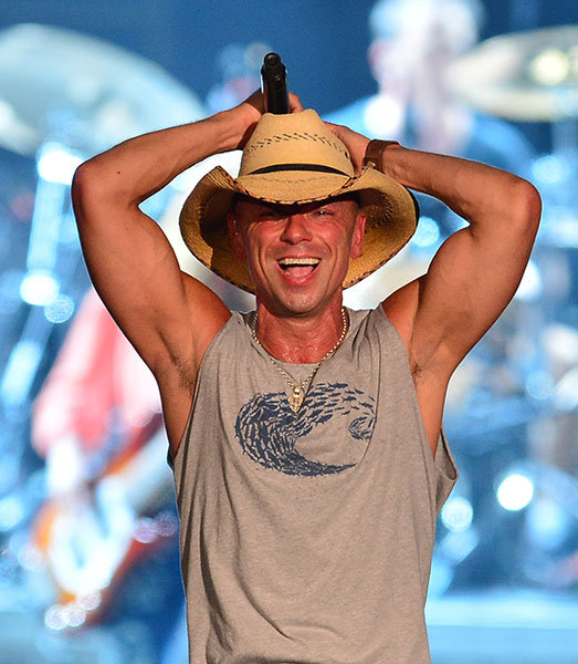 Kenny Chesney laughing at a sad kitten