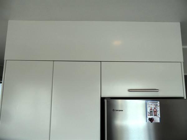 Bulkhead to ceiling (above cupboards)