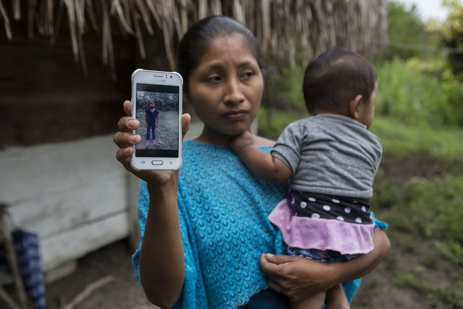 """Jakelin Ameí Rosmery Caal Maquin's mother Claudia displays a photograph of the child. """"Every time they ask me what happened to the girl, it hurts me again."""" (via AP)"""