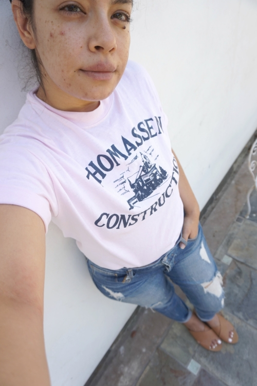 Thrifted tee: $1.99  Jeans: Bebe distressed jeans $23  Thrifted sandals: Aldo $3.00