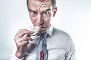 businessman eating.jpg