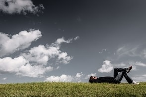 Person laying Thinking about happiness