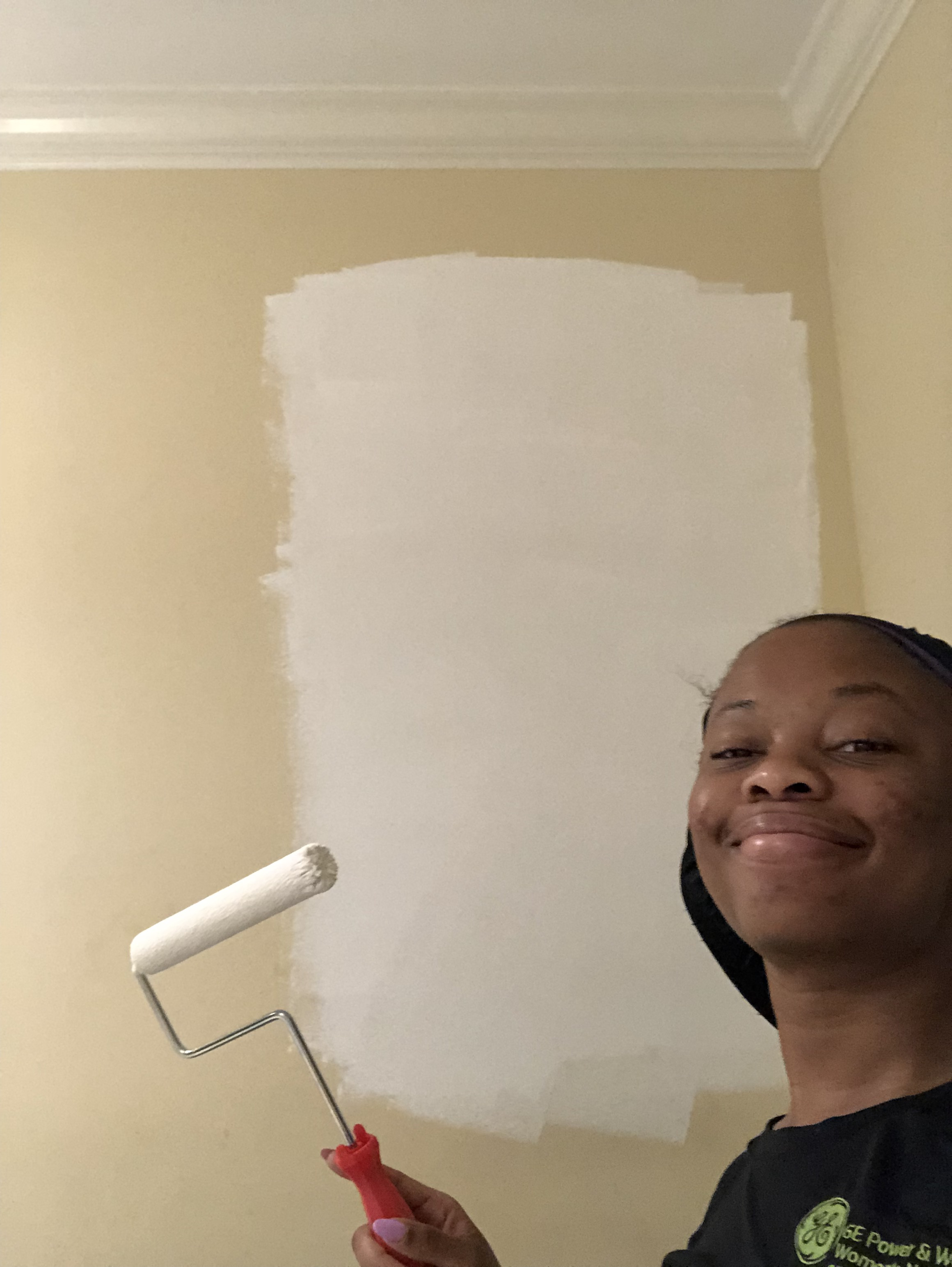Taking a moment to appreciate the first few rolls of paint on the wall with a selfie.