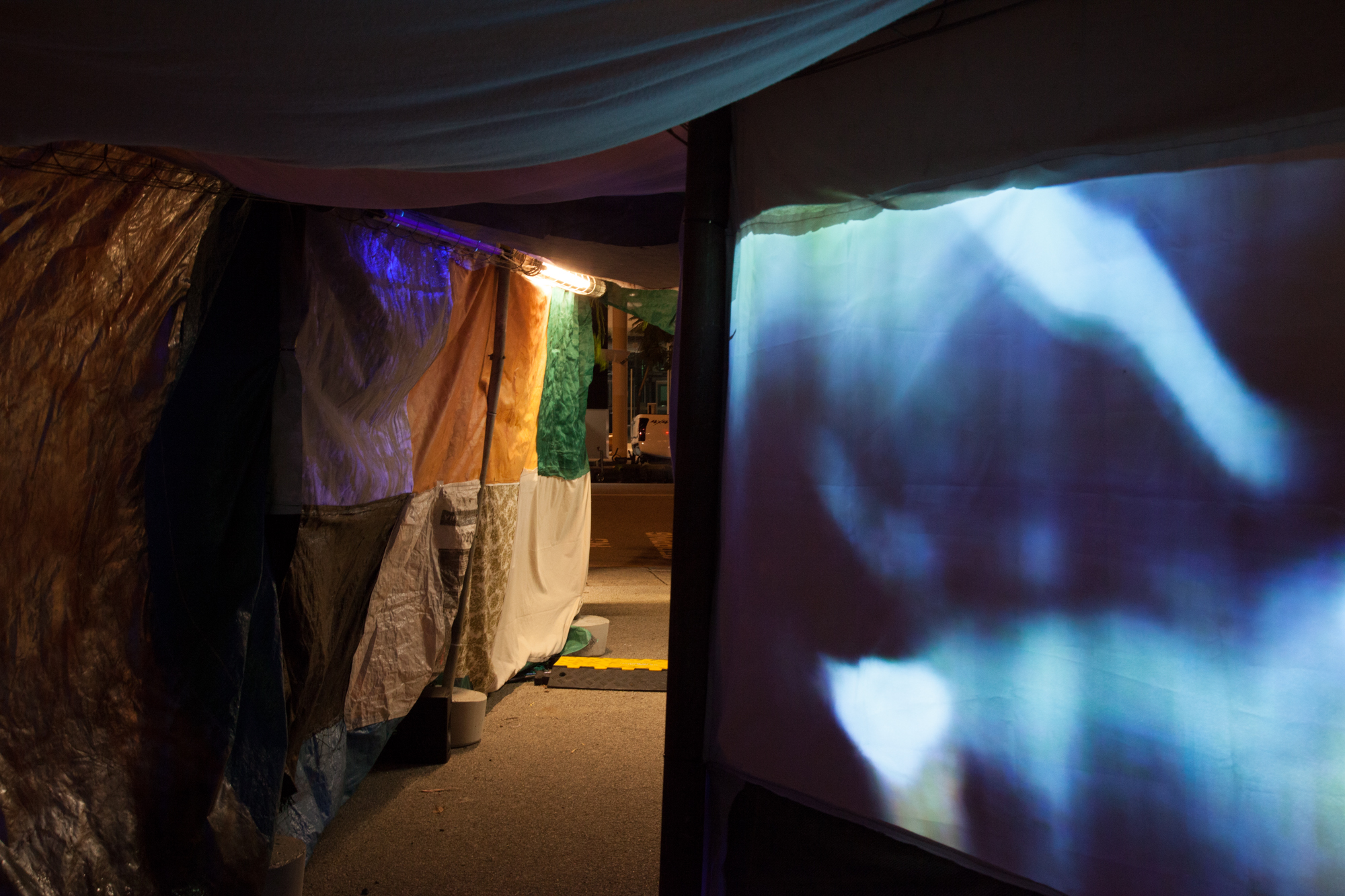 Slushbox , tunnel made from salvaged fabrics, Neil Aldum, Erin Coates and Simone Johnston.  Undergo , video projection inside tunnel, Loren Holmes Photography: Yvonne Doherty