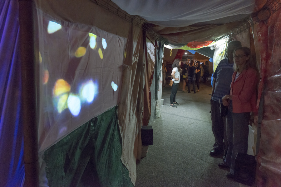 Slushbox , tunnel made from salvaged fabrics, Neil Aldum, Erin Coates and Simone Johnston.  Undergo , video projection inside tunnel, Loren Holmes. Photography: Yvonne Doherty