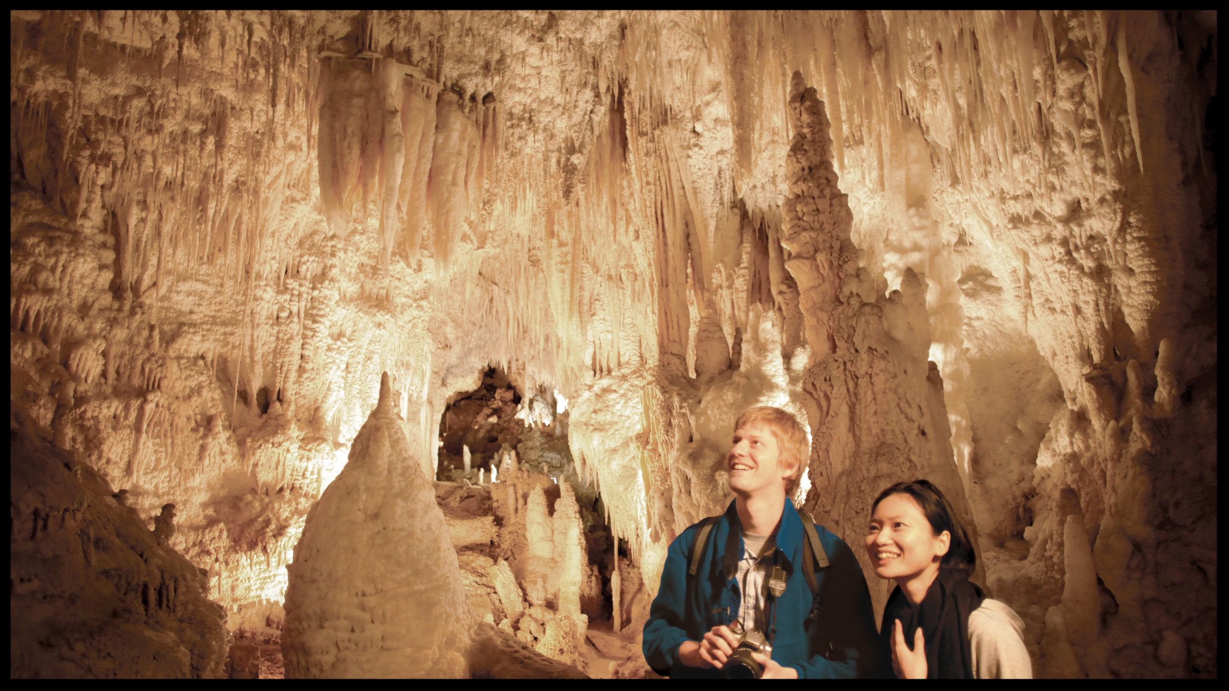 Aranui Cave 1516 NZ Couple Looking at Formations.jpg