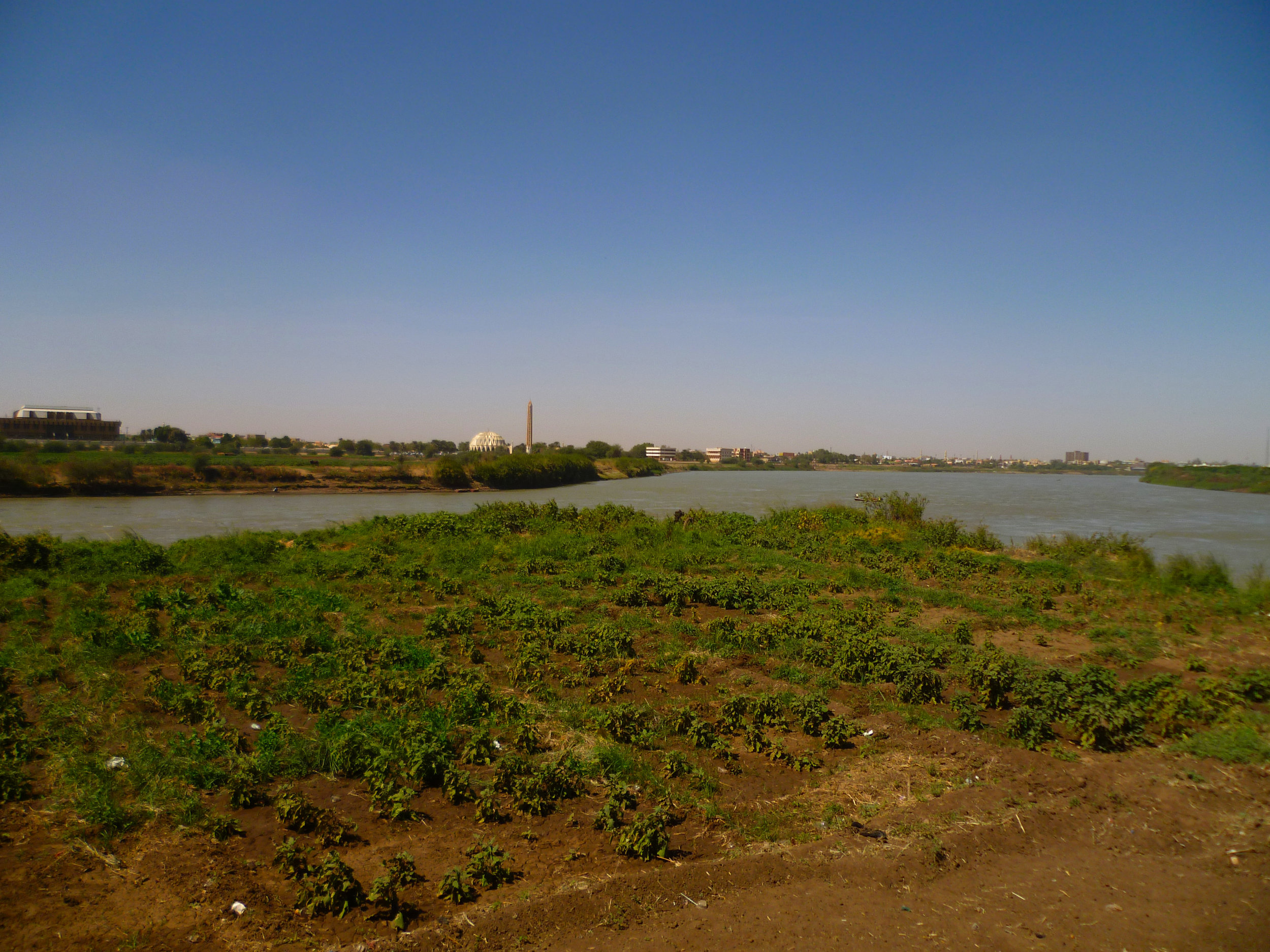 The unremarkable muddy patch of ground where the Blue and White Nile finally meet to become the infamous River Nile...